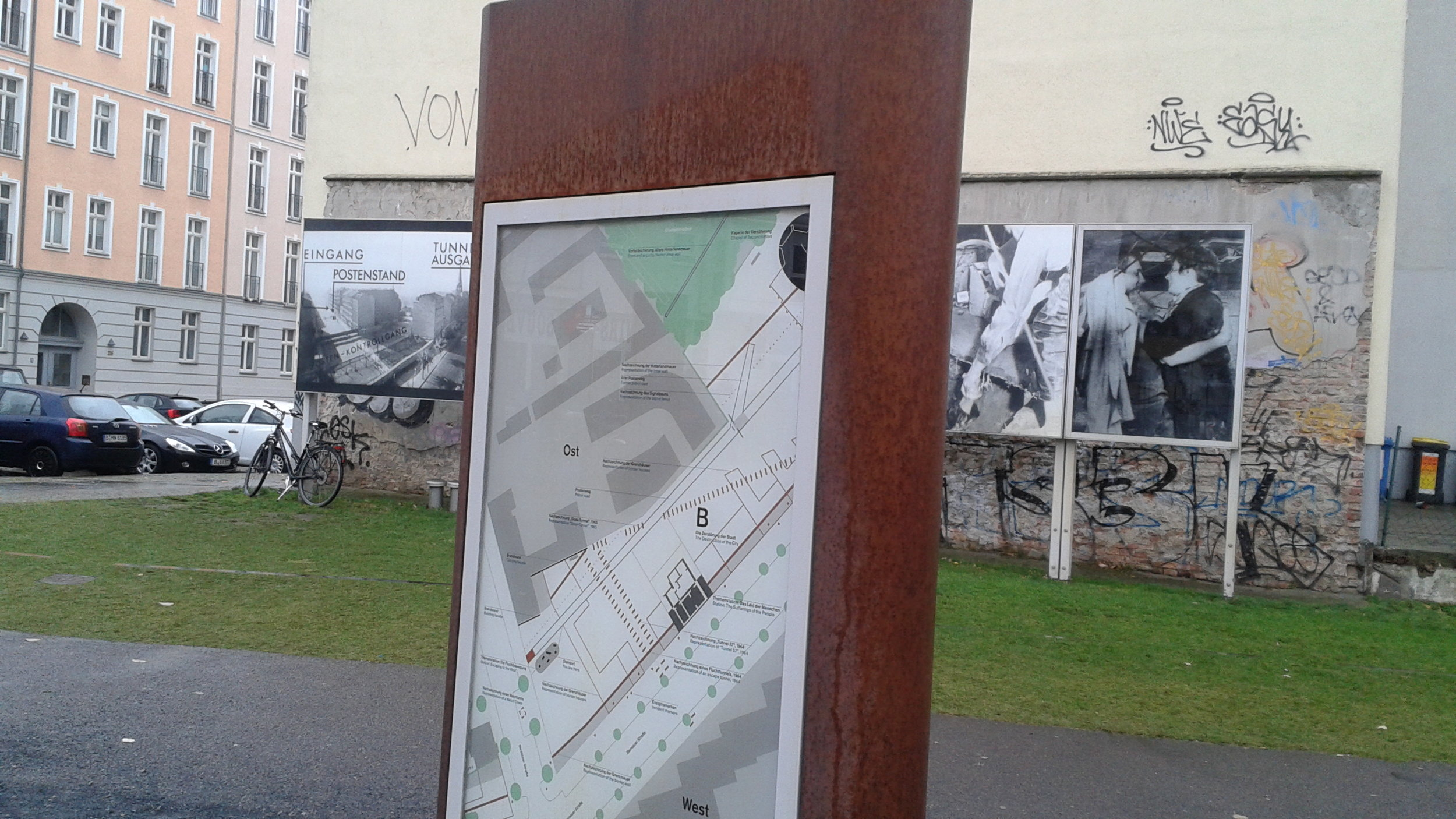 Sign marking where part of the Berlin wall used to bisect the neighborhood.