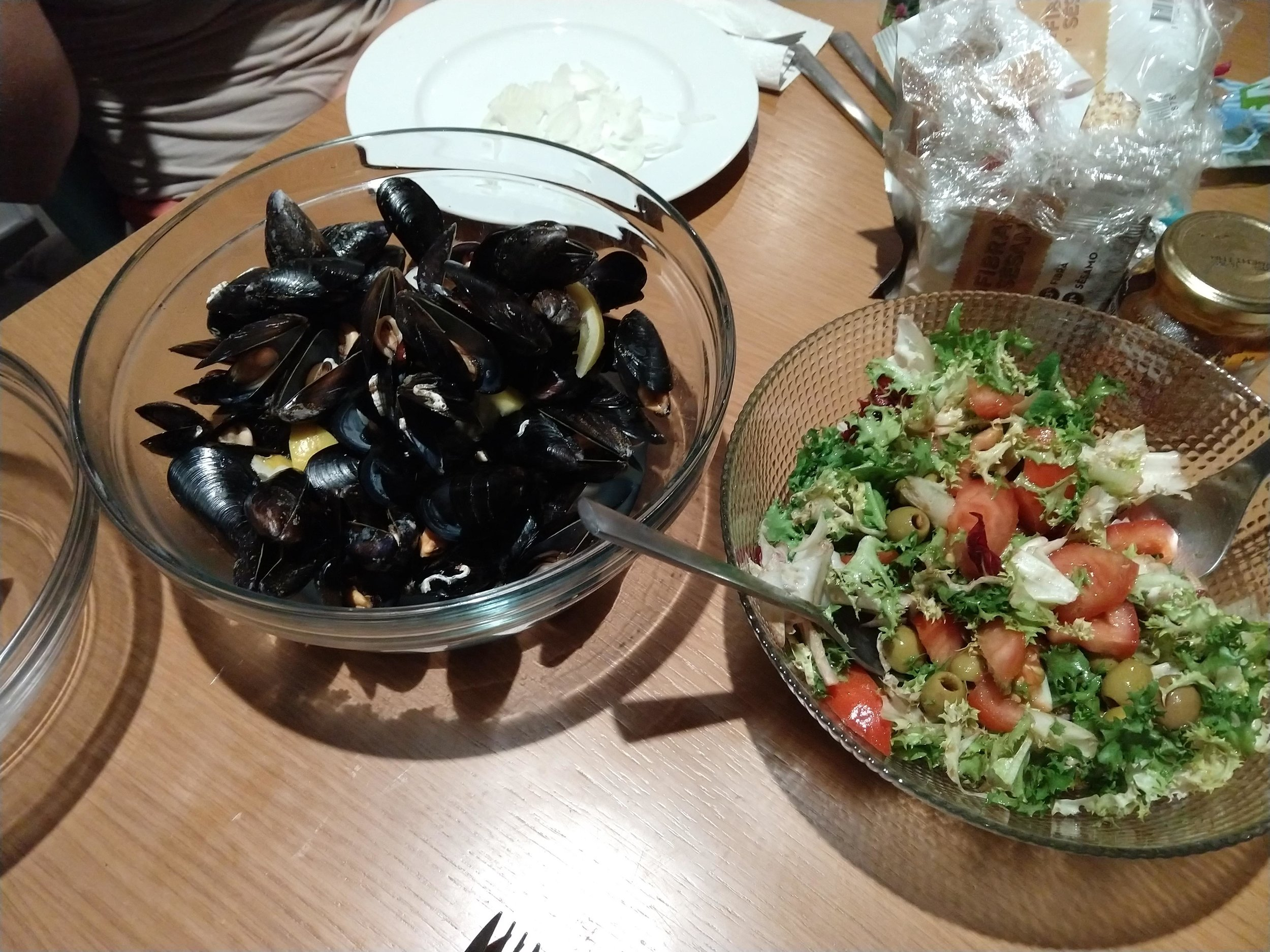 One night, my host's housemate shared her dinner with me: a simple meal of salad and simply cooked mussels.
