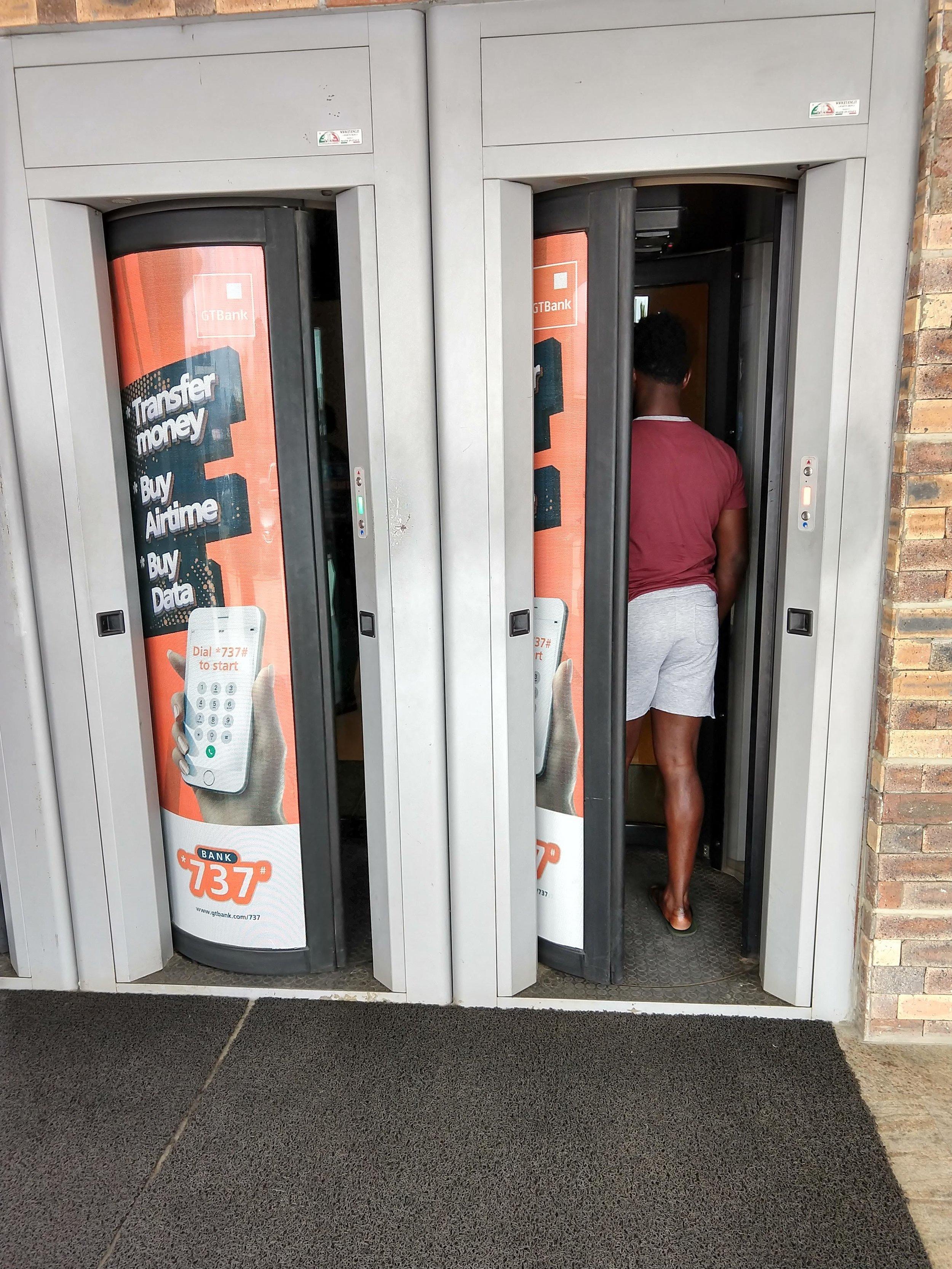 Secure entrances outside a bank on the Lagos island.
