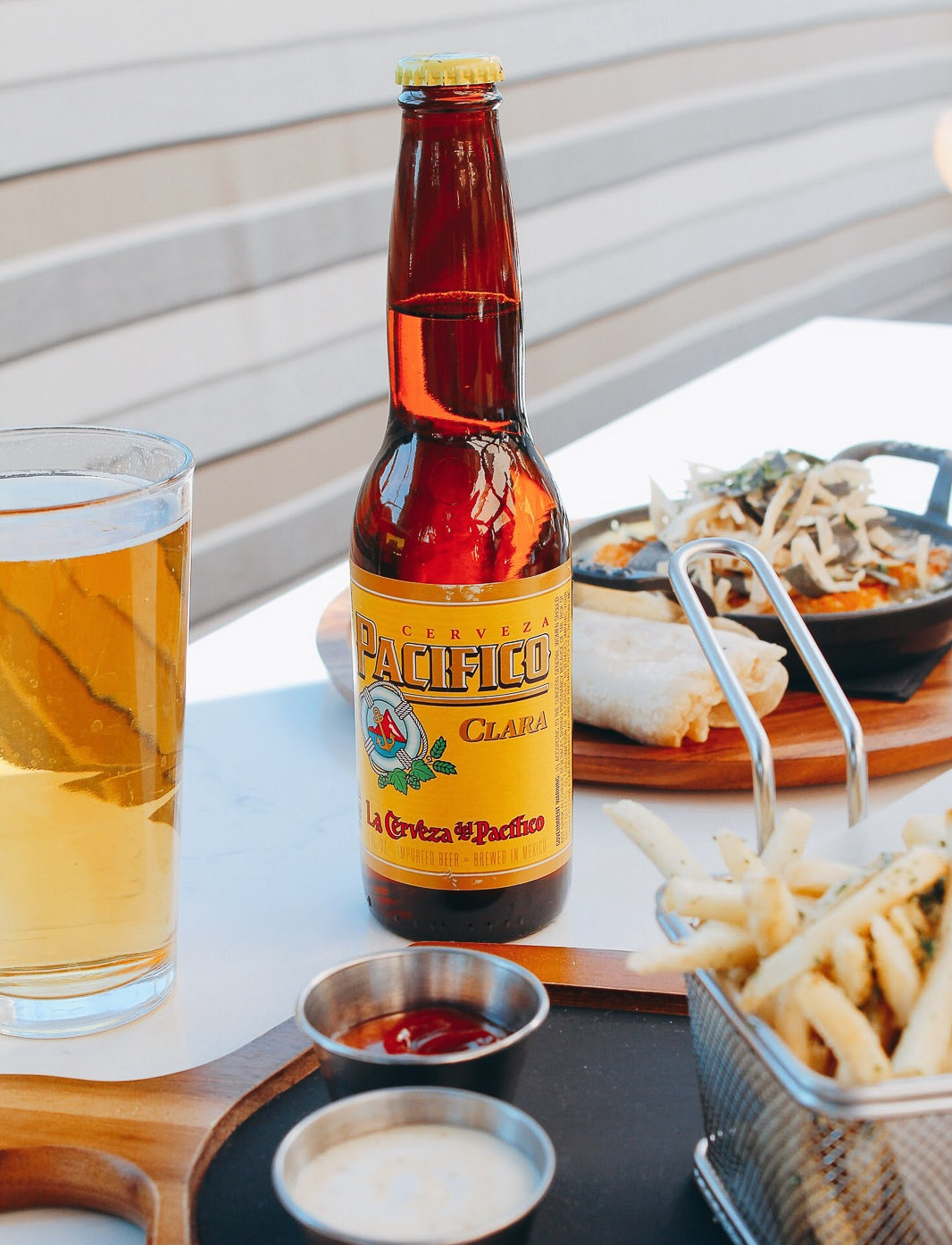 Pacifico Bottle and Pint Glass of Beer