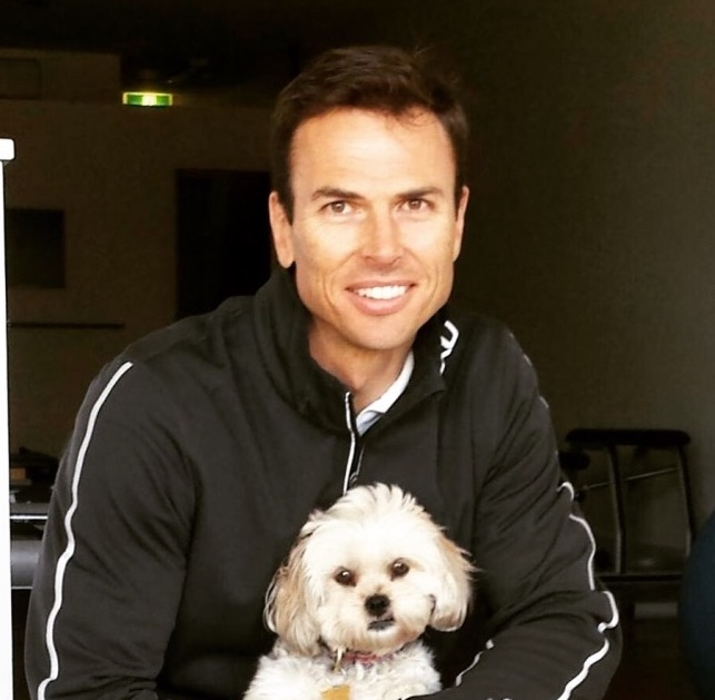 Chris with Cookie the studio mascot