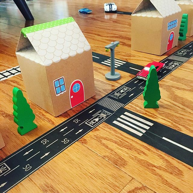 Road tape ✅ Repurposed cardboard gingerbread houses ✅ Hotwheels ✅ Wooden train accessories...HOURS of fun. 🚂🚗🏡 #saturdayvibes