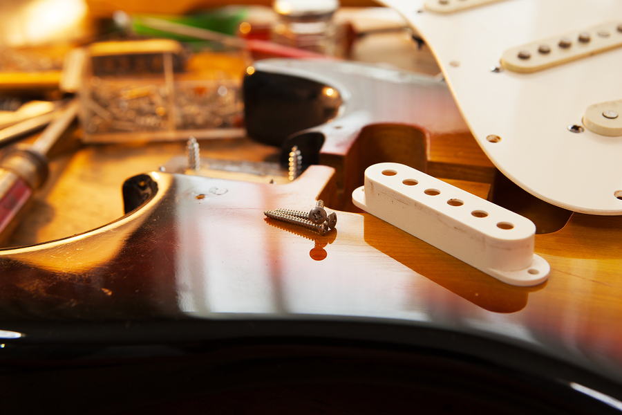 bigstock-Sunburst-electric-guitar-body-55534784.jpg
