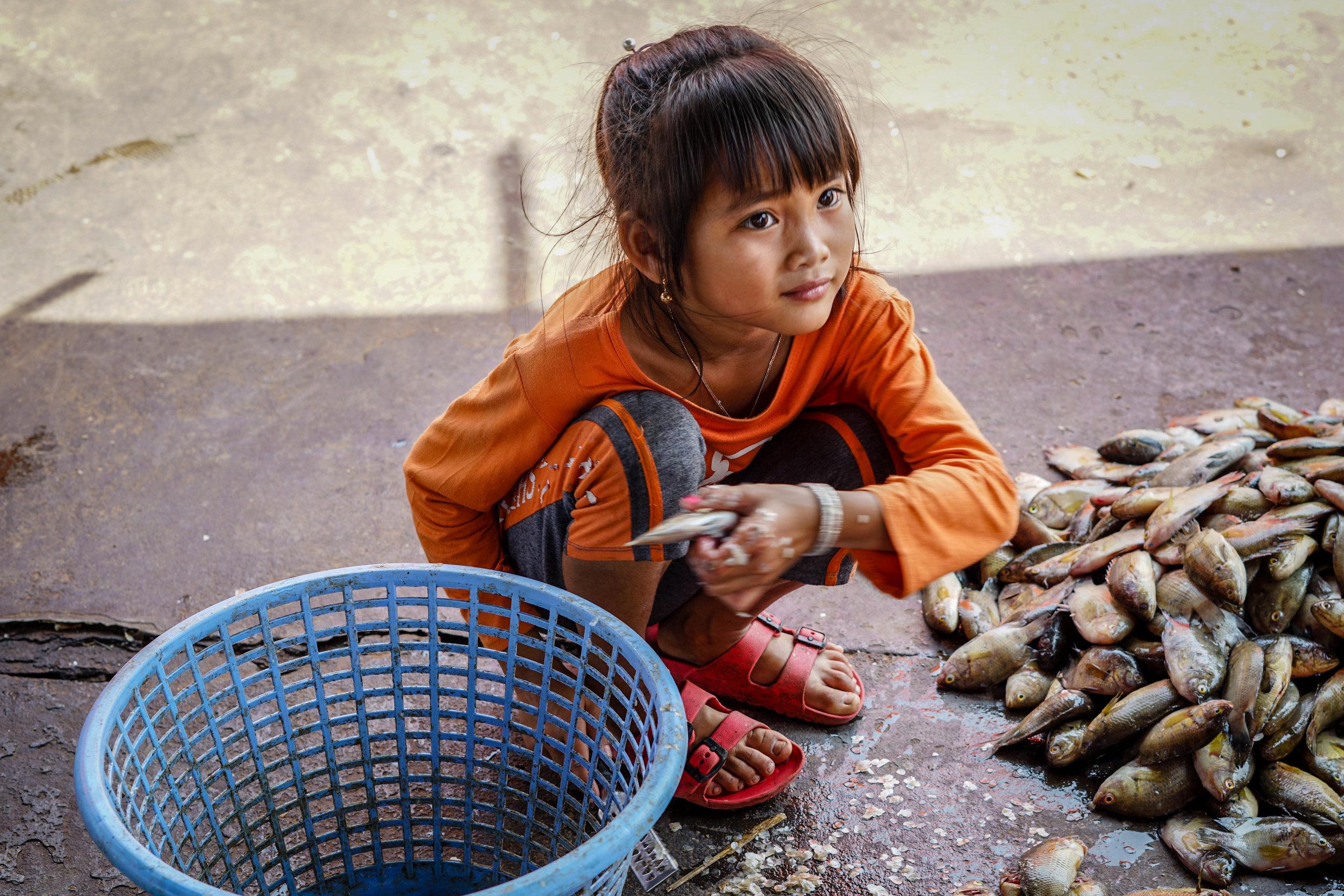 Girl with fish | Cambodia   ©LaurenKanaChan