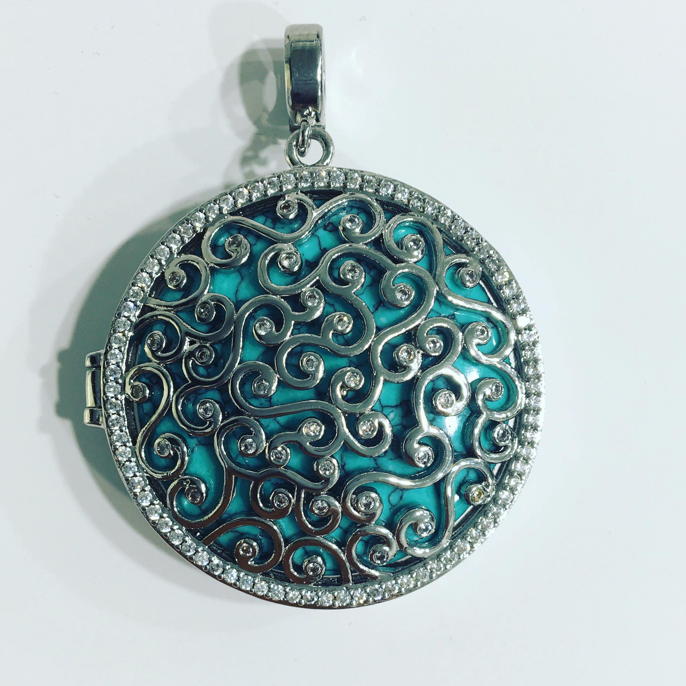 Stunning  Dream Catcher Pendant  ($238) with turquoise insert www.diamondsdirect.co.nz