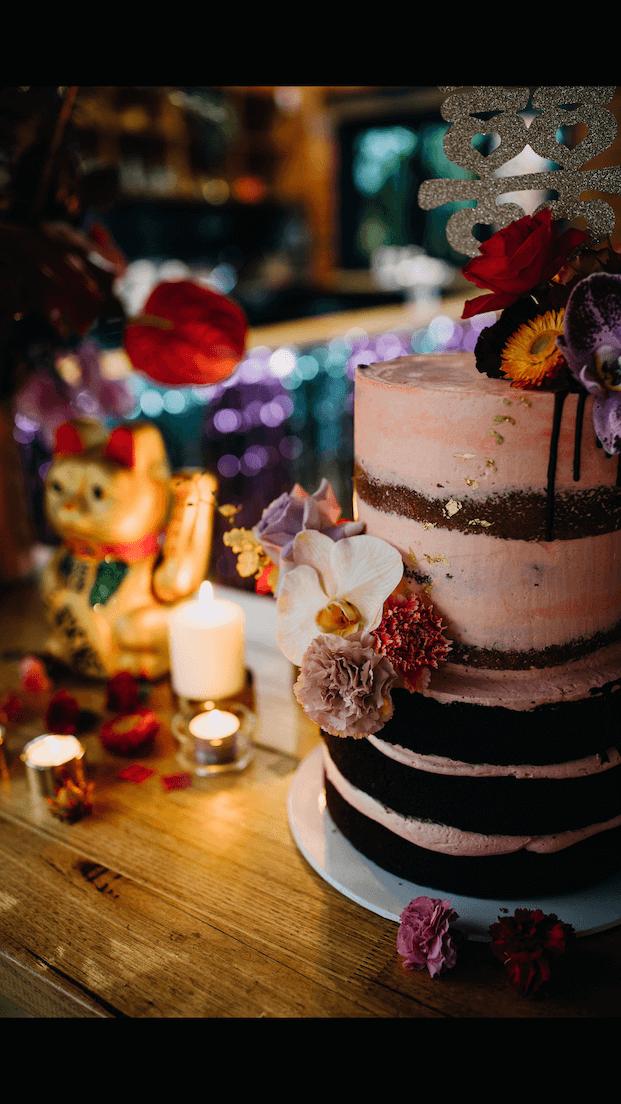 Wedding, cake, semi naked, flowers.png