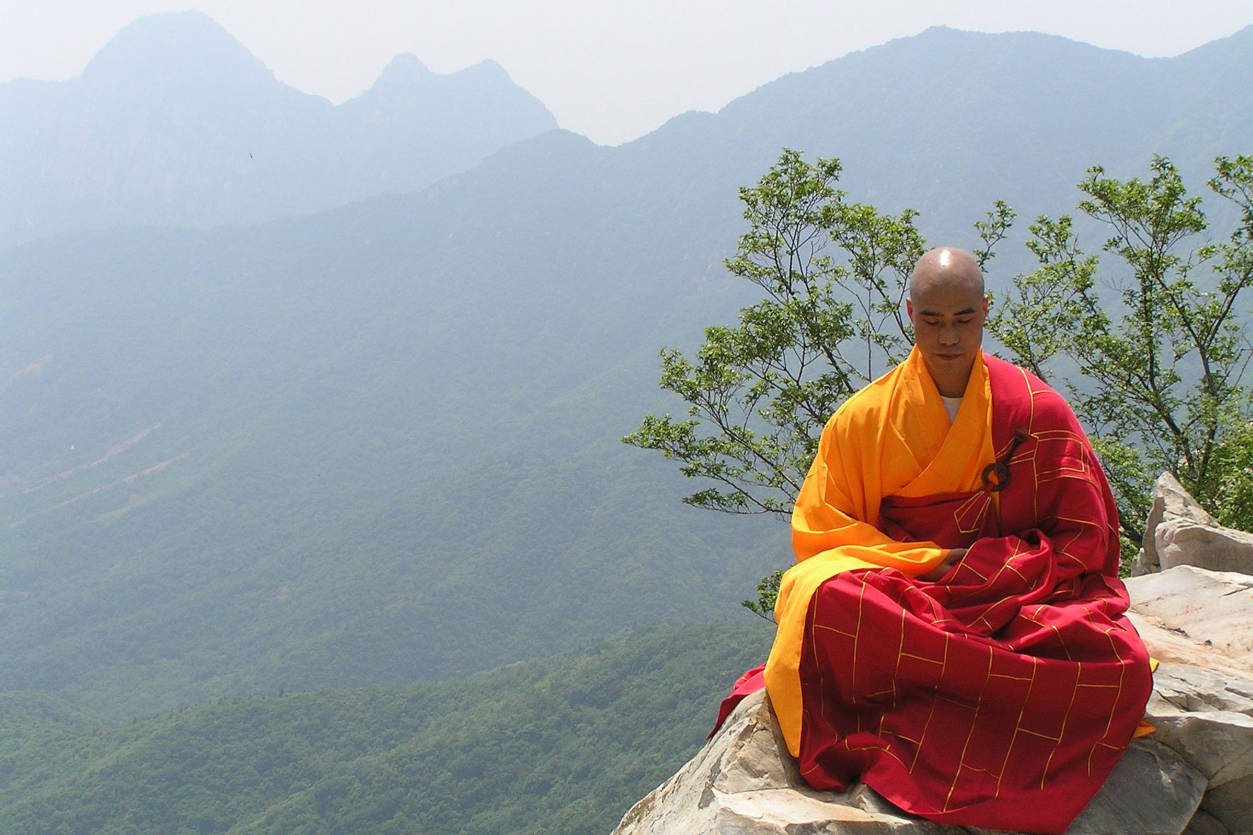 A Shaolin Monk in meditation practise with full robes.