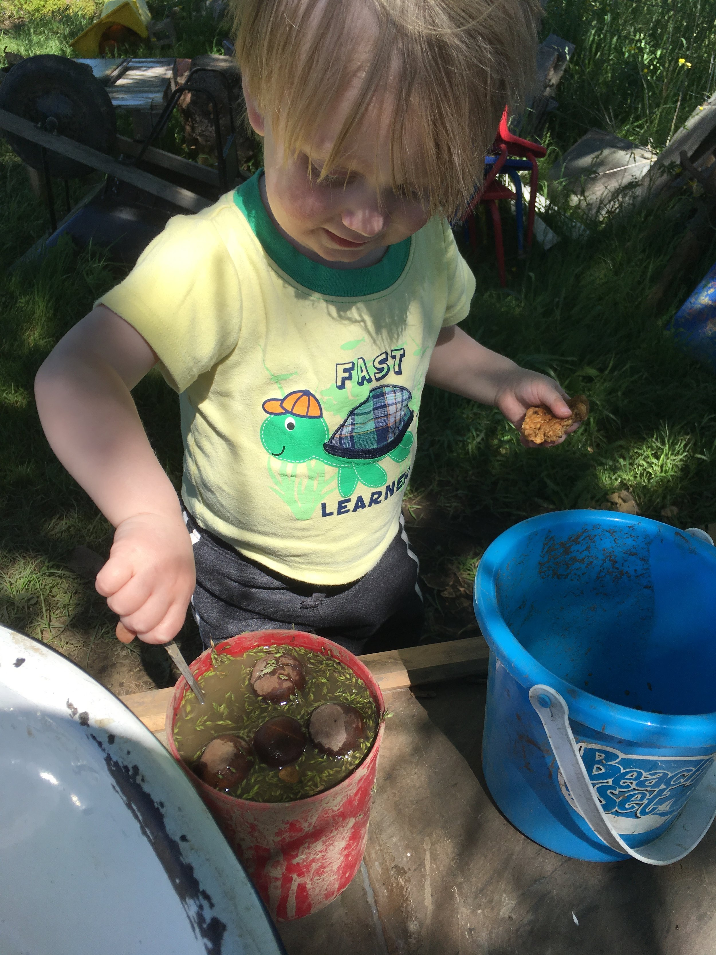 Making soup in the mud kitchen