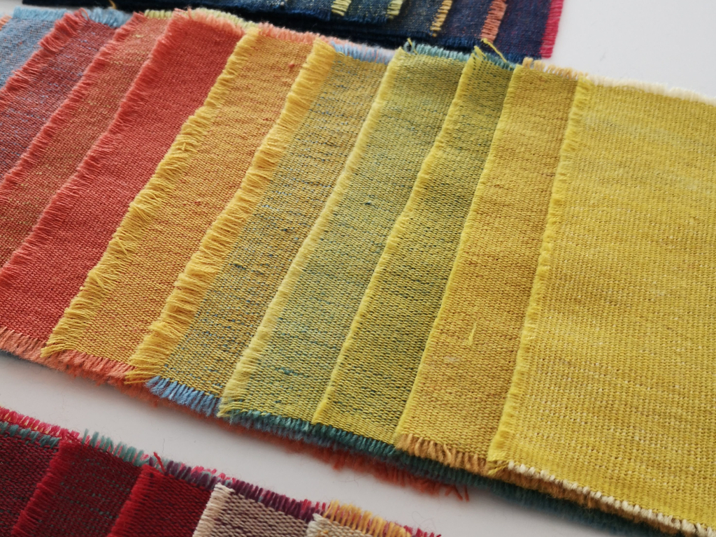 this would allow me to experiment with different colour combinations in an 'end on end' cloth by varying the weft threads intersecting the warp. these samples are presented in a simple fashion to allow the beauty of the natural colour to shine