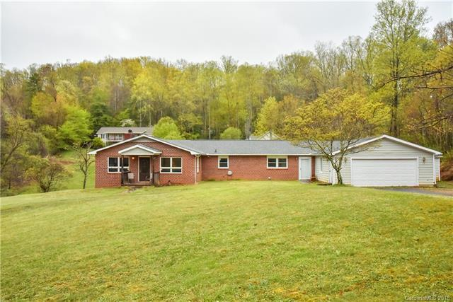 78 Concord RoadAsheville, NC 28803 - Amazing single level 2,000+ sq ft ranch style home. Wide open space in master bedroom, living room and garage. Additional 23 x 27 and 14 x 21 unfinished space behind garage. Flat 1.5 acres convenient to Airport Rd, Hendersonville Rd, Sweeten Creek Rd. Minutes from shopping, food, & recreation. Everything you need and more. Builders and developers could turn this into a duplex/multi-family home with the potential to build other homes on the 1.5 acres. The possibilities are endless! Come see today!