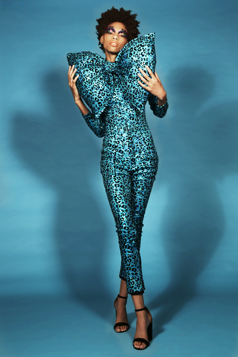 Turquoise animal print bodysuit, pant and oversized bow by  CHENG,  Heels by  cesare paciotti