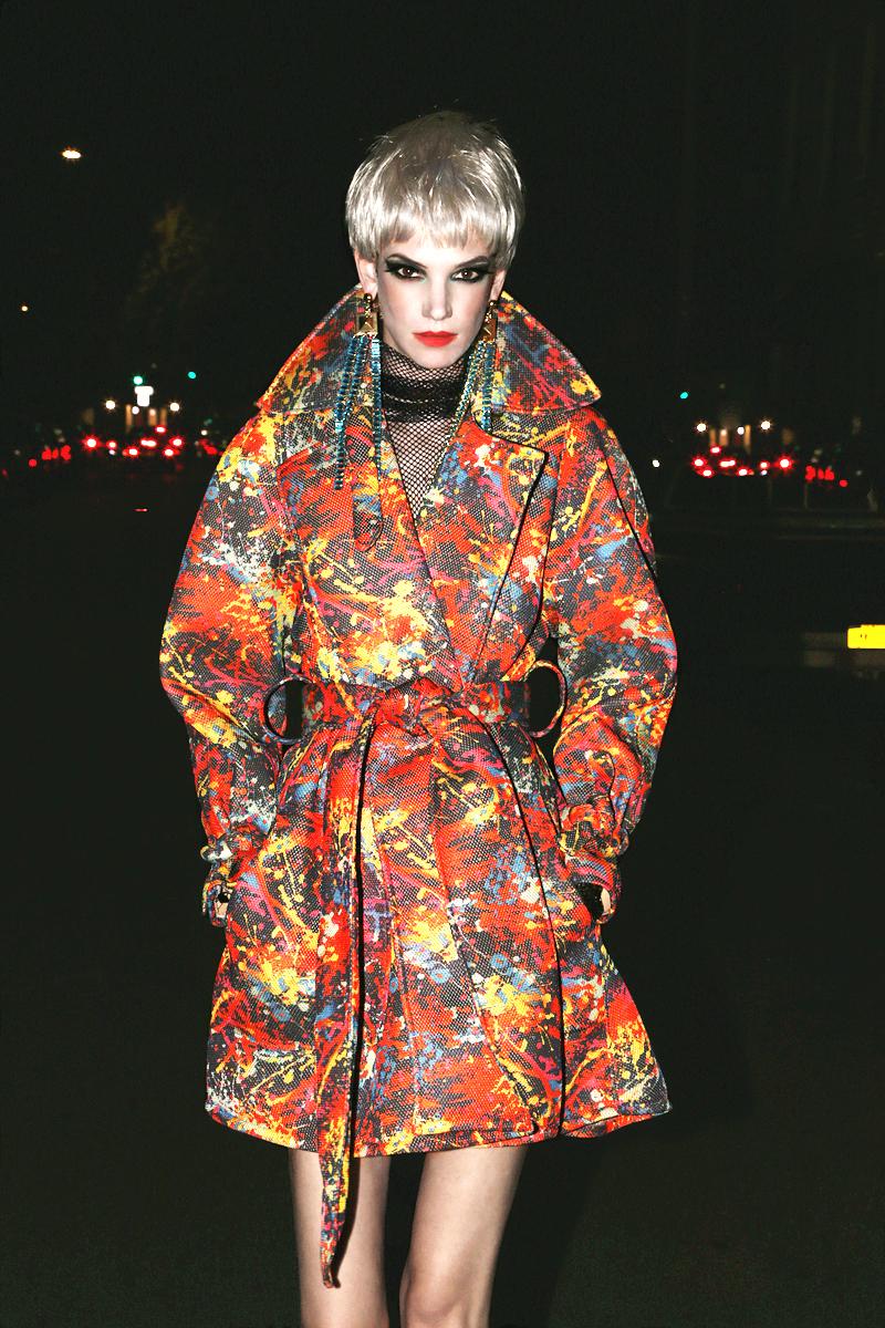 Coat  David Darlymple of Patricia Field ARTFashion,  Black fishnet top  Nude,  Earrings  Laruicci