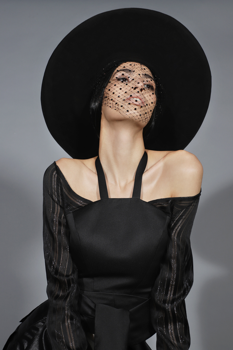 Hat by  Victor Osborne , Veil by  Victoria Hayes,  Mya Off the Shoulder Top & Thesis Layered Skirt By  Arianne Elmy