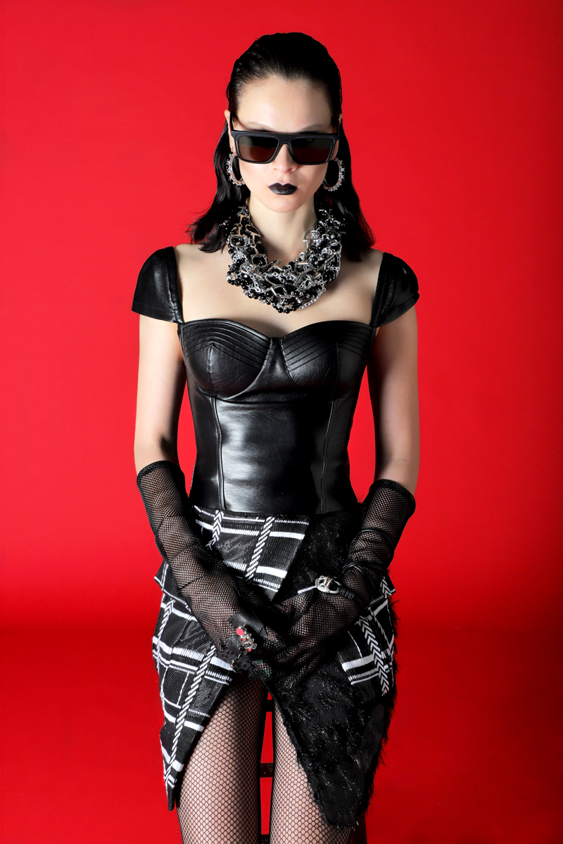 Sunglasses by  Yohji Yamamoto at Dreems NYC,  Necklace by  Nicole Hayduga at Dreems NYC,  Earrings by  Adore Adorn at Dreems NYC,  Gloves BY  Wing & Weft Gloves , Skirt by  Vivienne Hu,  Top by  Gwen Salakaia at Dreems NYC