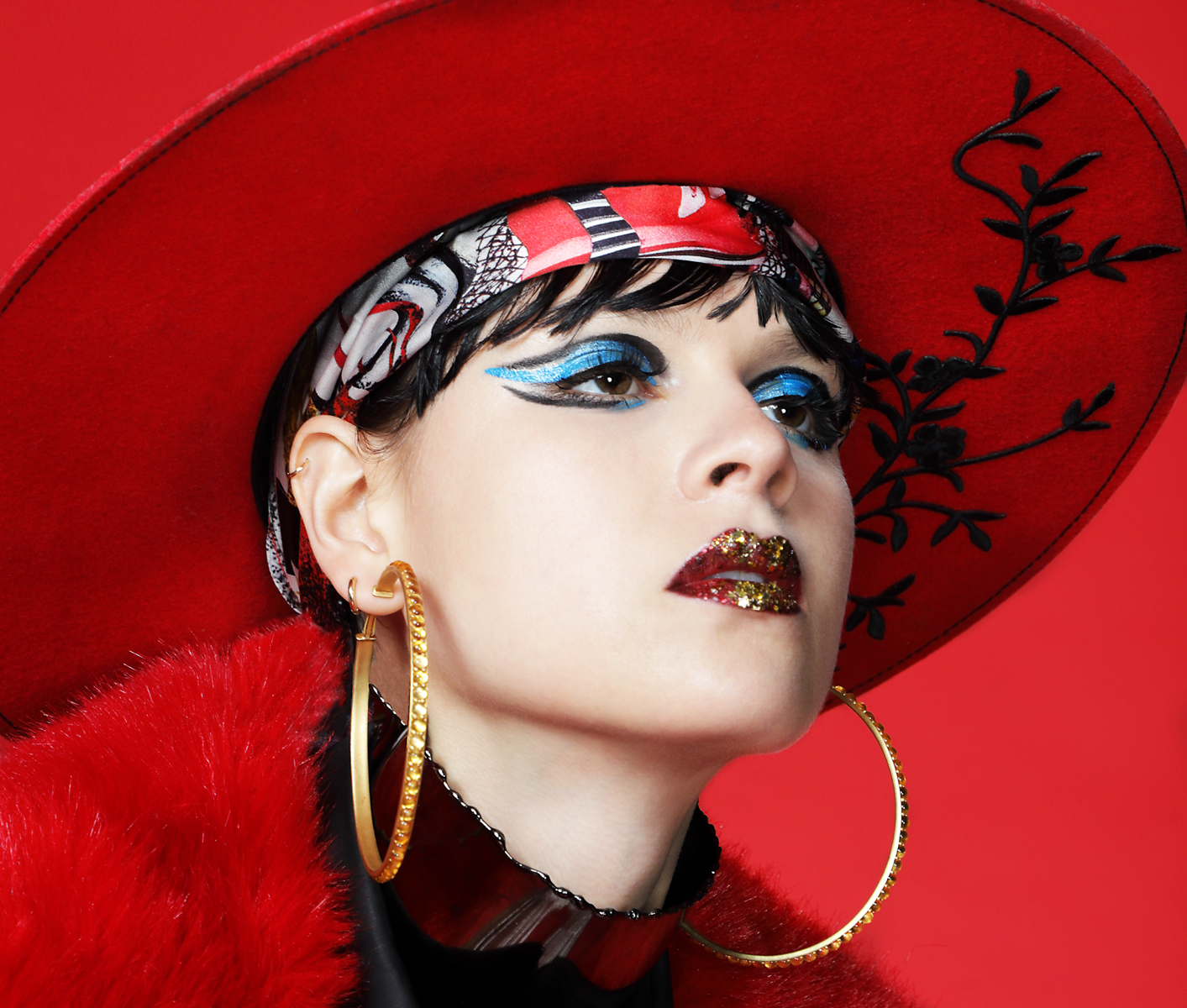 Hat by  GLAMROCKS , Scarf by  VALENTINA AVRAMIDES at Flying Solo,  Earrings by  Adore Adorn at Dreems NYC,  Choker by  GBGH JEWELRY at Flying Solo,  Jacket by  NARCISS by Alise Trautmane at Dreems NYC