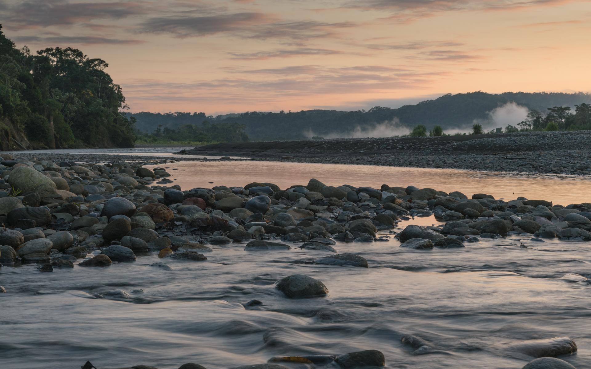 Sunrise reflecting on the Alto Madre de Dios River