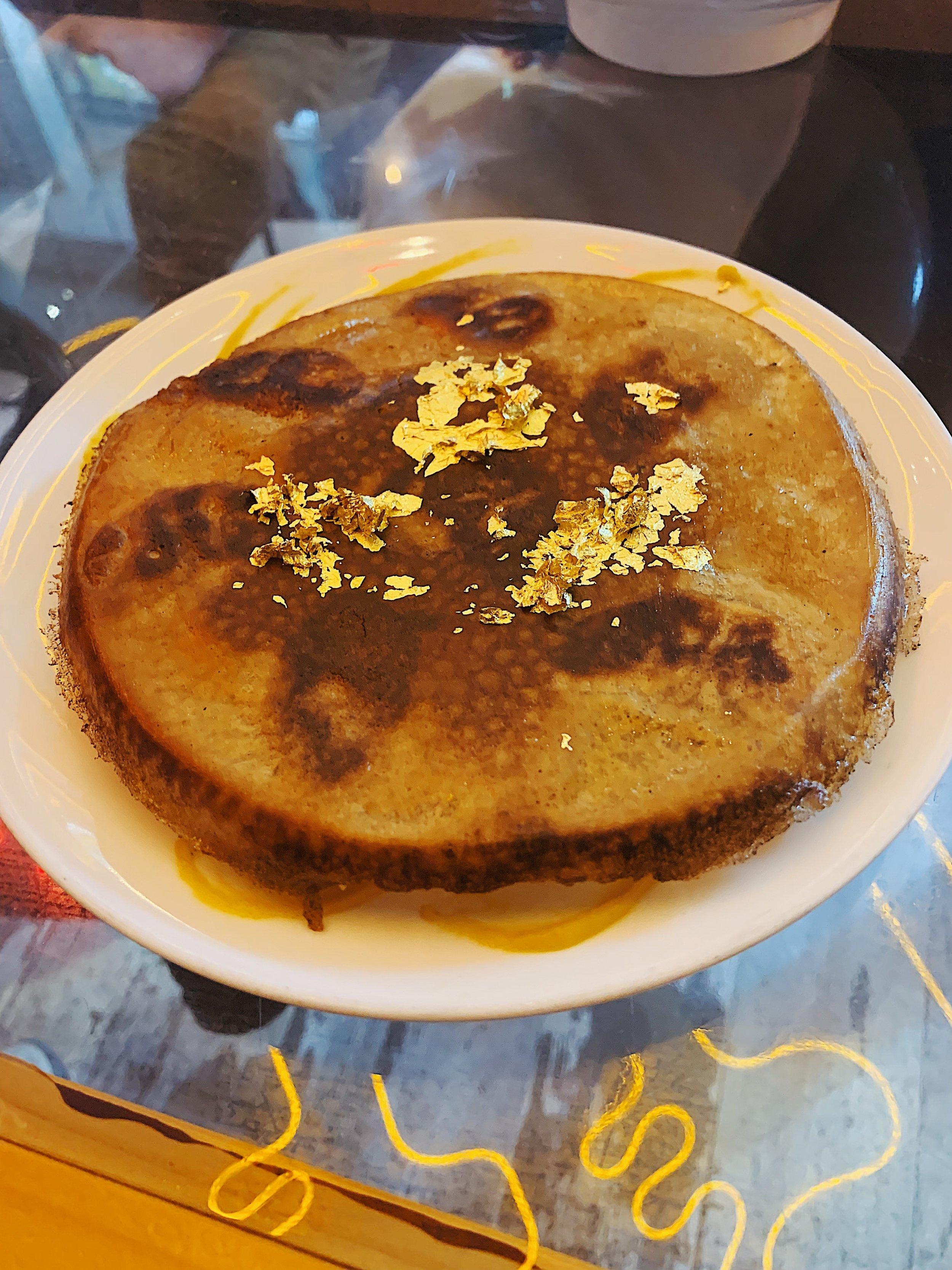 Pegao Norteño; Lamb pot sticker, aderezo norteño, crispy cumin lace, gold flake