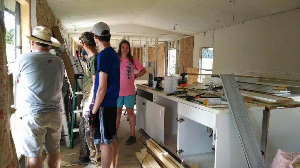 Volunteers and construction.jpg