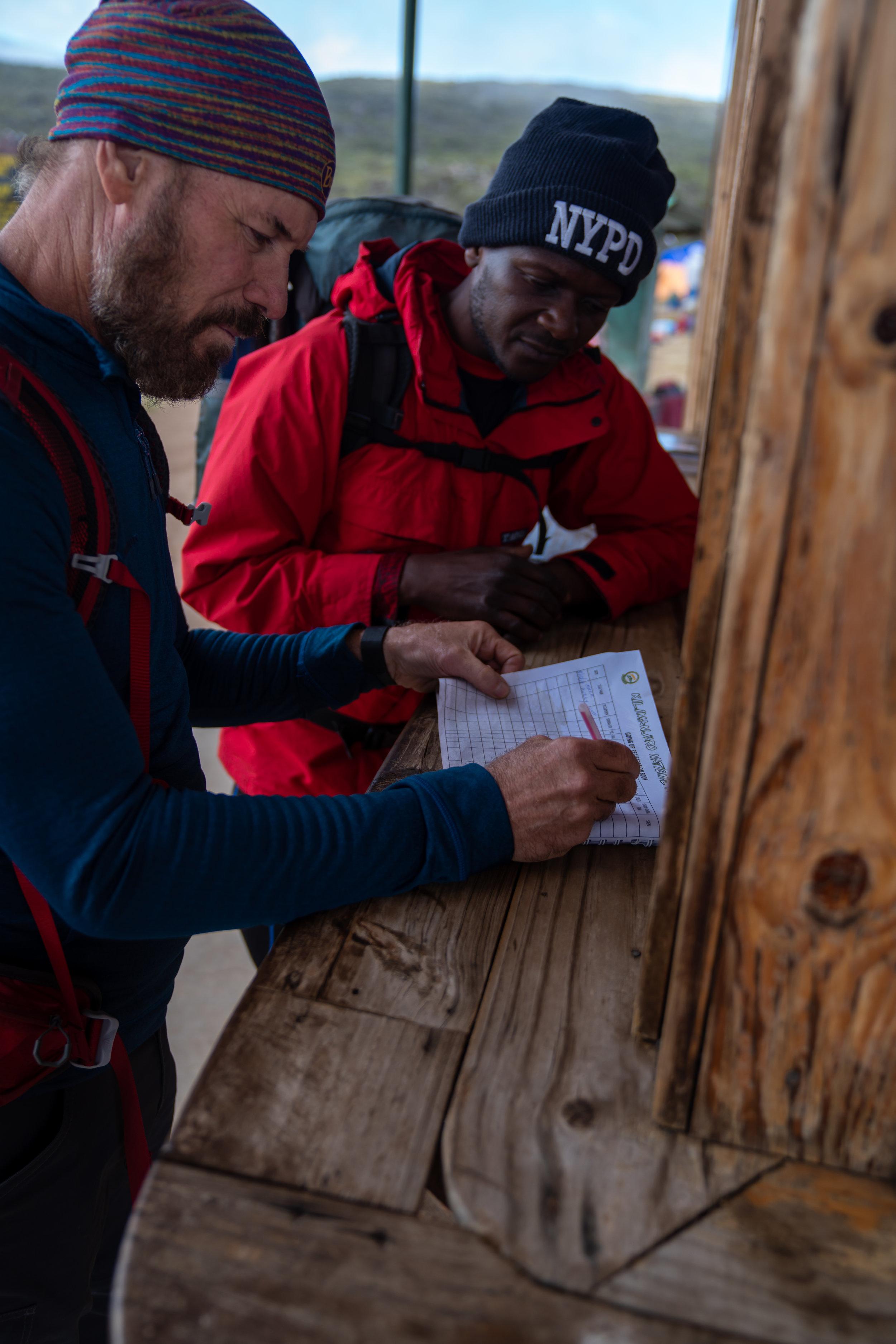 Mark signing in at Shira Camp 1.