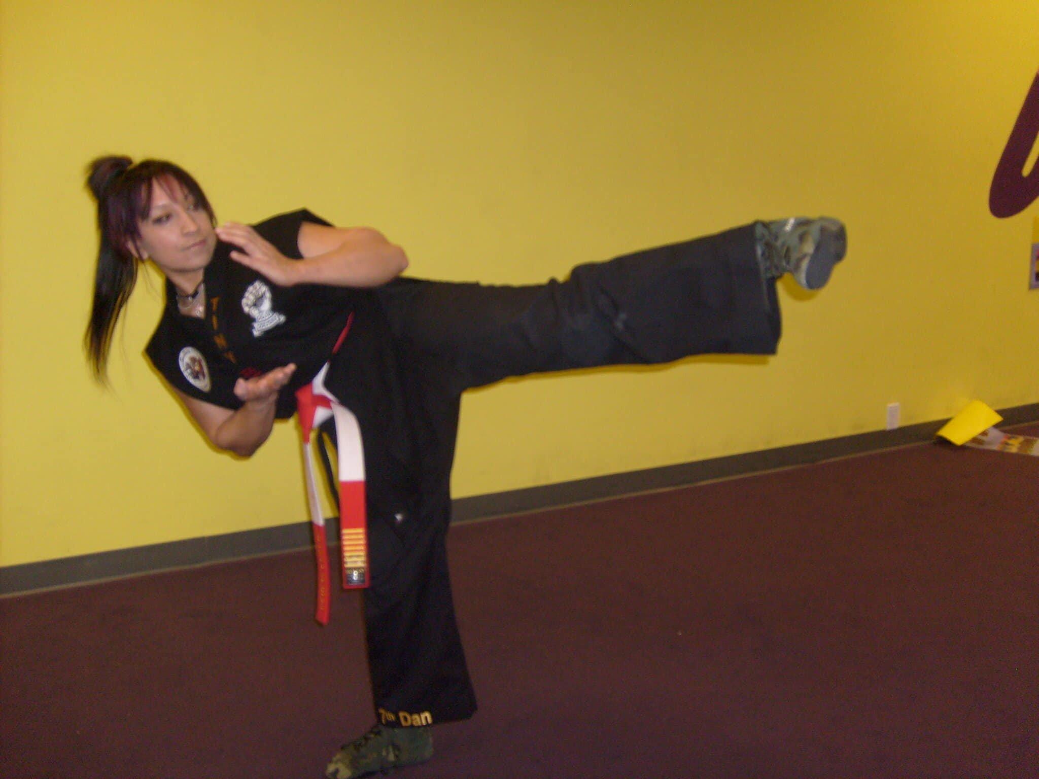 Nancie as a 7th Dan/degree black belt in karate. She's currently a 9th degree black belt.