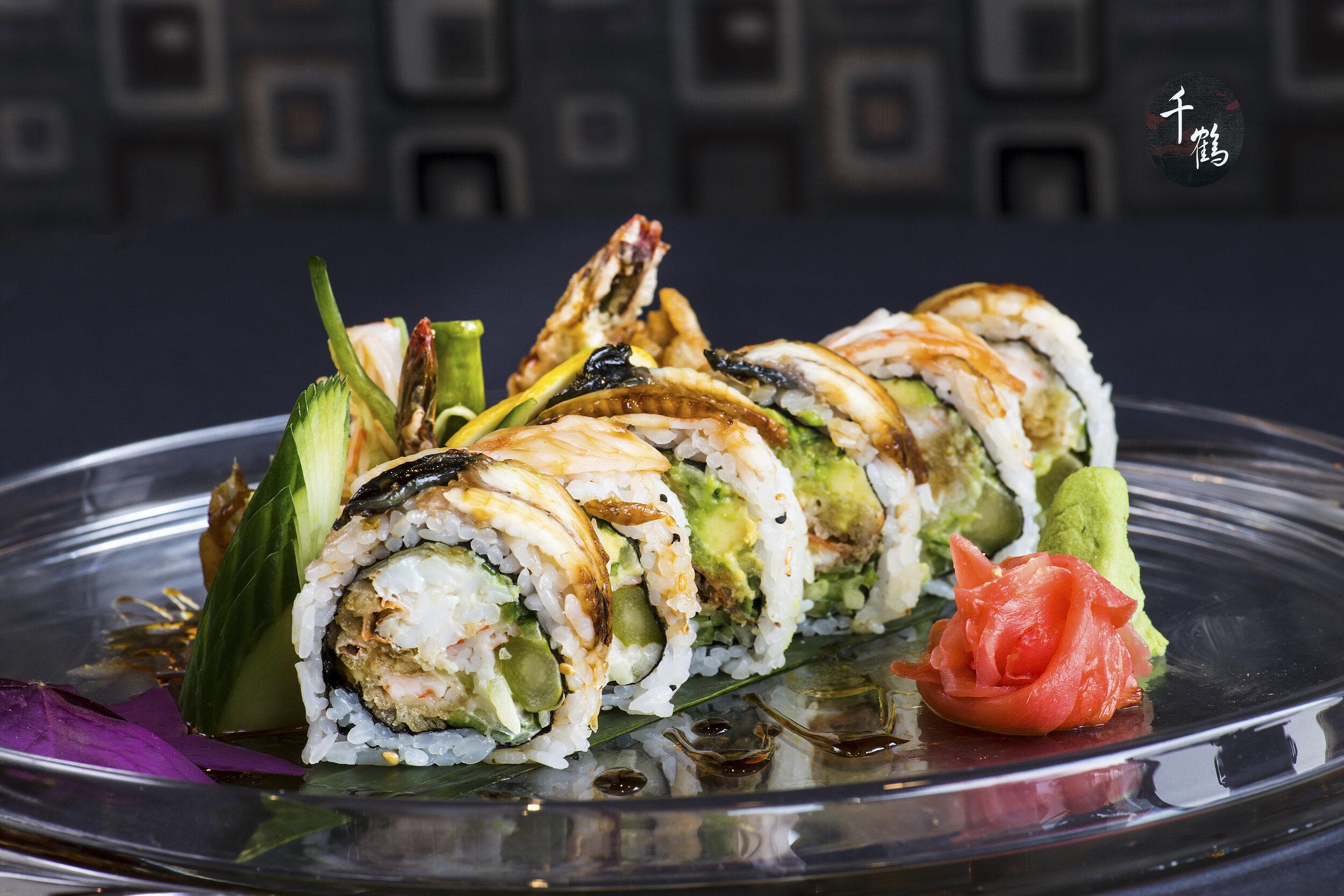 Phoenix Roll (8) $16.99 Soft Shell Crab, Tempura Shrimp, Avocado,  Cucumber, Asparagus, Fish Eggs, Spicy Mayo, Topped w Shrimp &Eel.