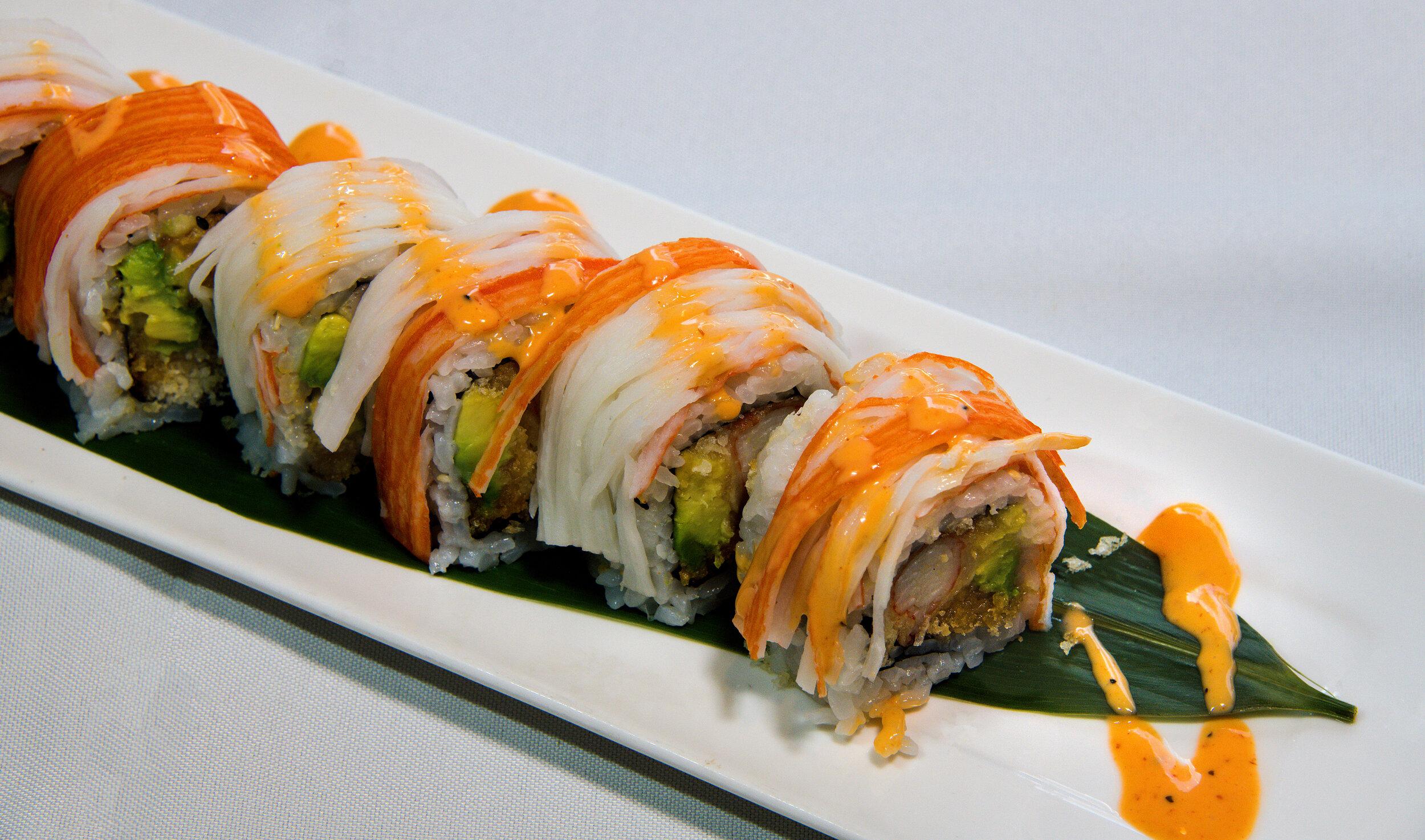 Sakura Roll (8) $9.99 Tempura Crab, Avocado, Topped w Crab & Spicy Mayo.