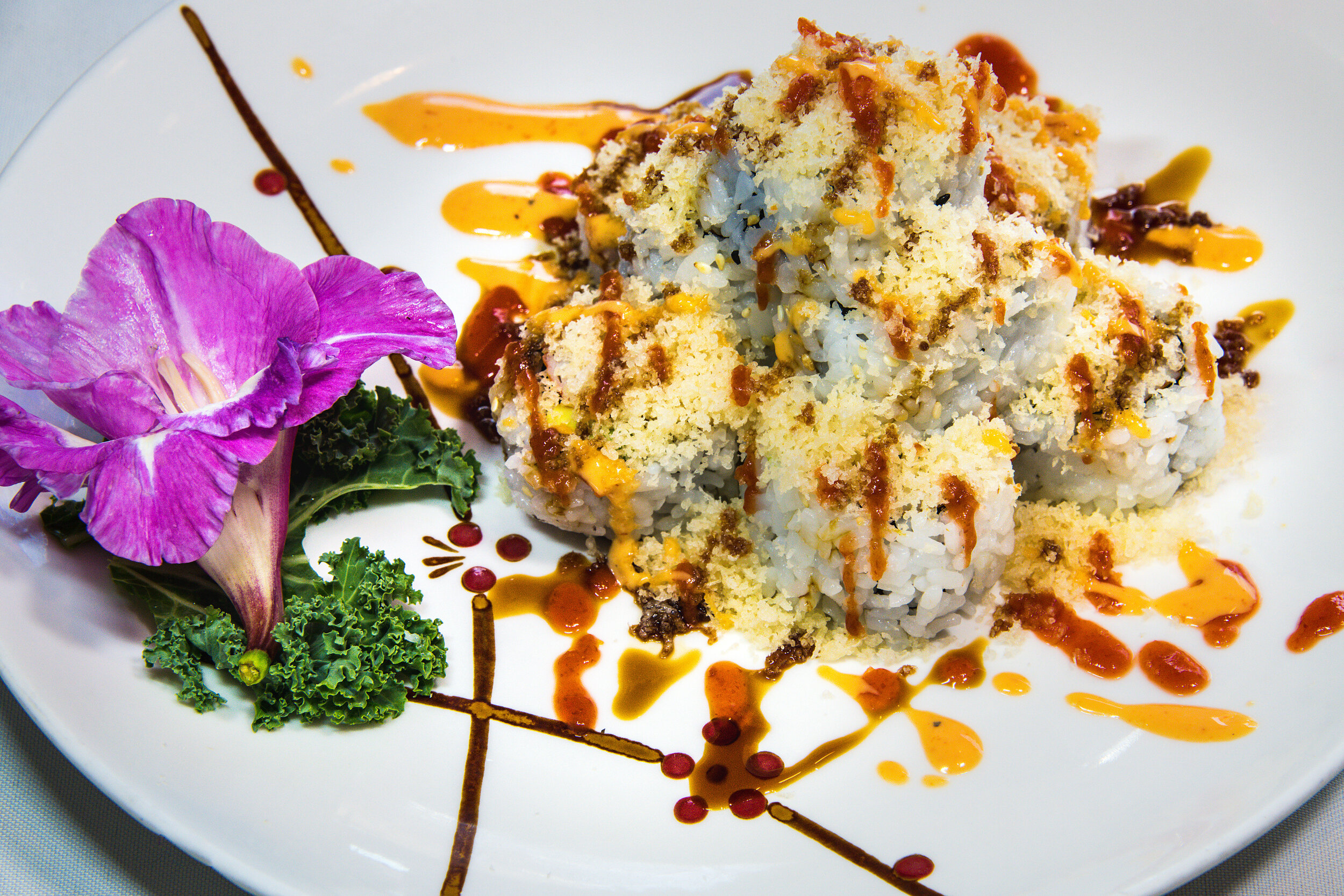 Volcano Roll (8) $9.99 Crab Meat Avocado Topped w Tempura Flake & Spicy Sauce
