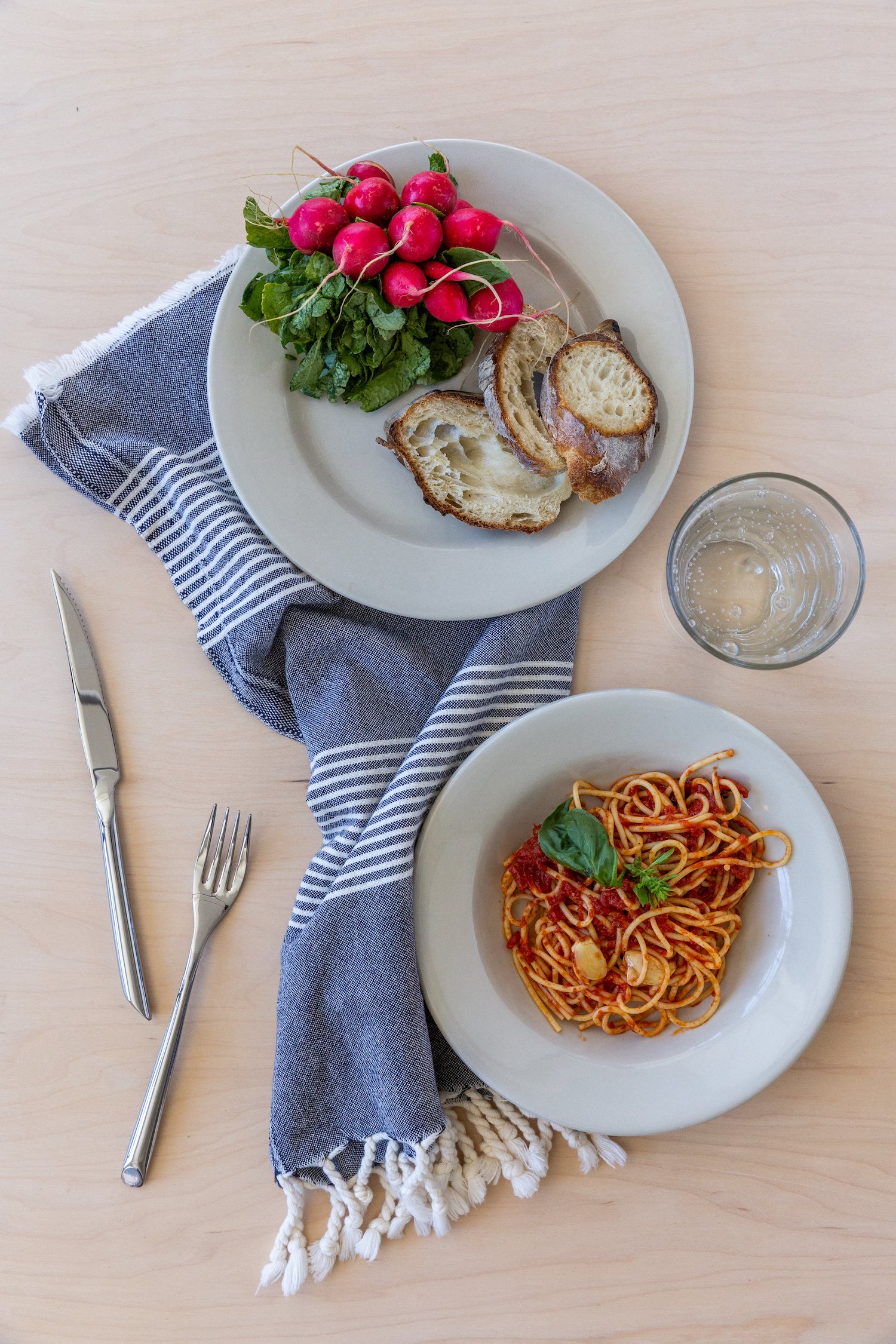 Plates, bowls, glasses, forks, table knives