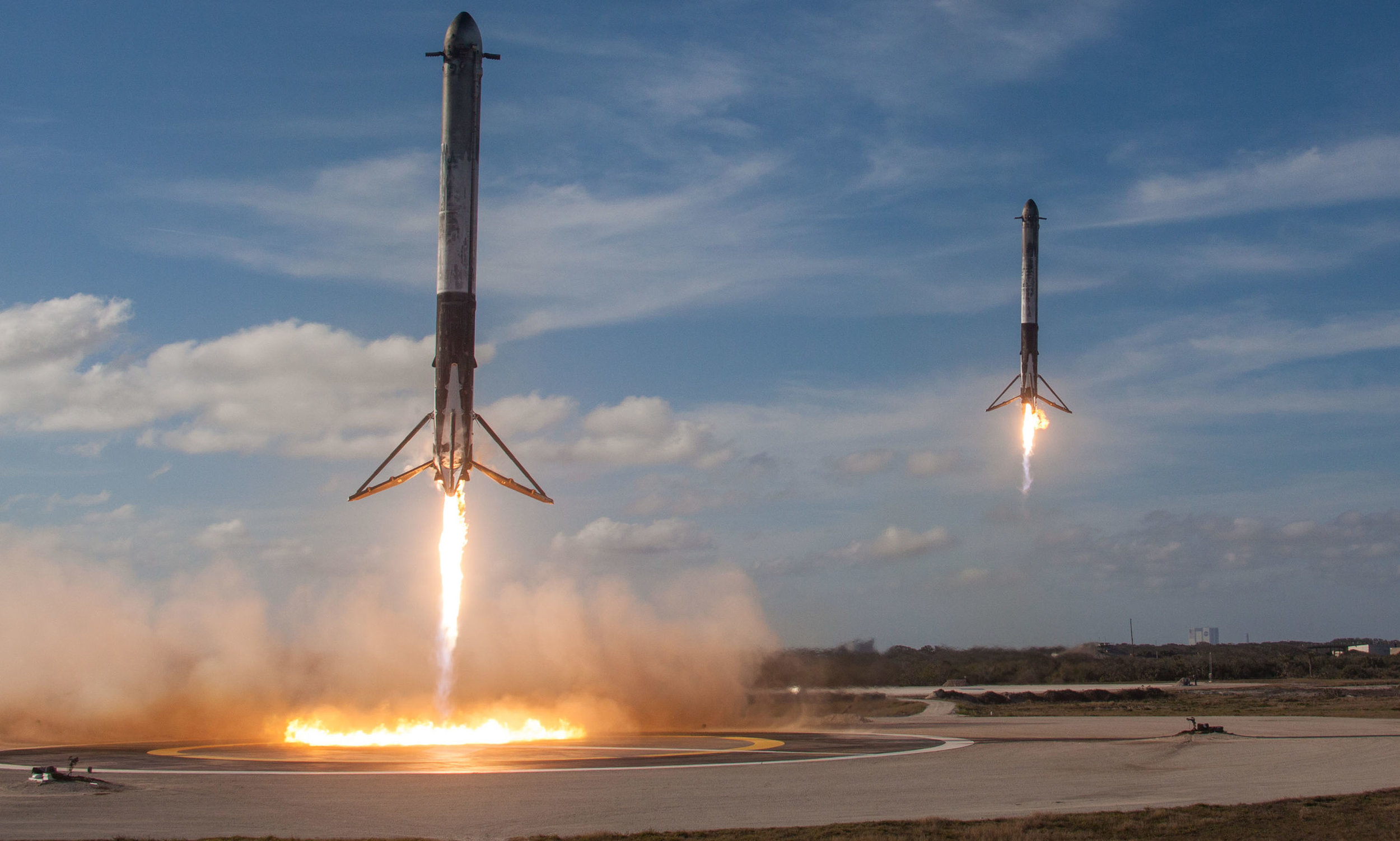 Two of SpaceX's outer cores touch down on concrete landing pads at Cape Canaveral, Florida. Credit: SpaceX