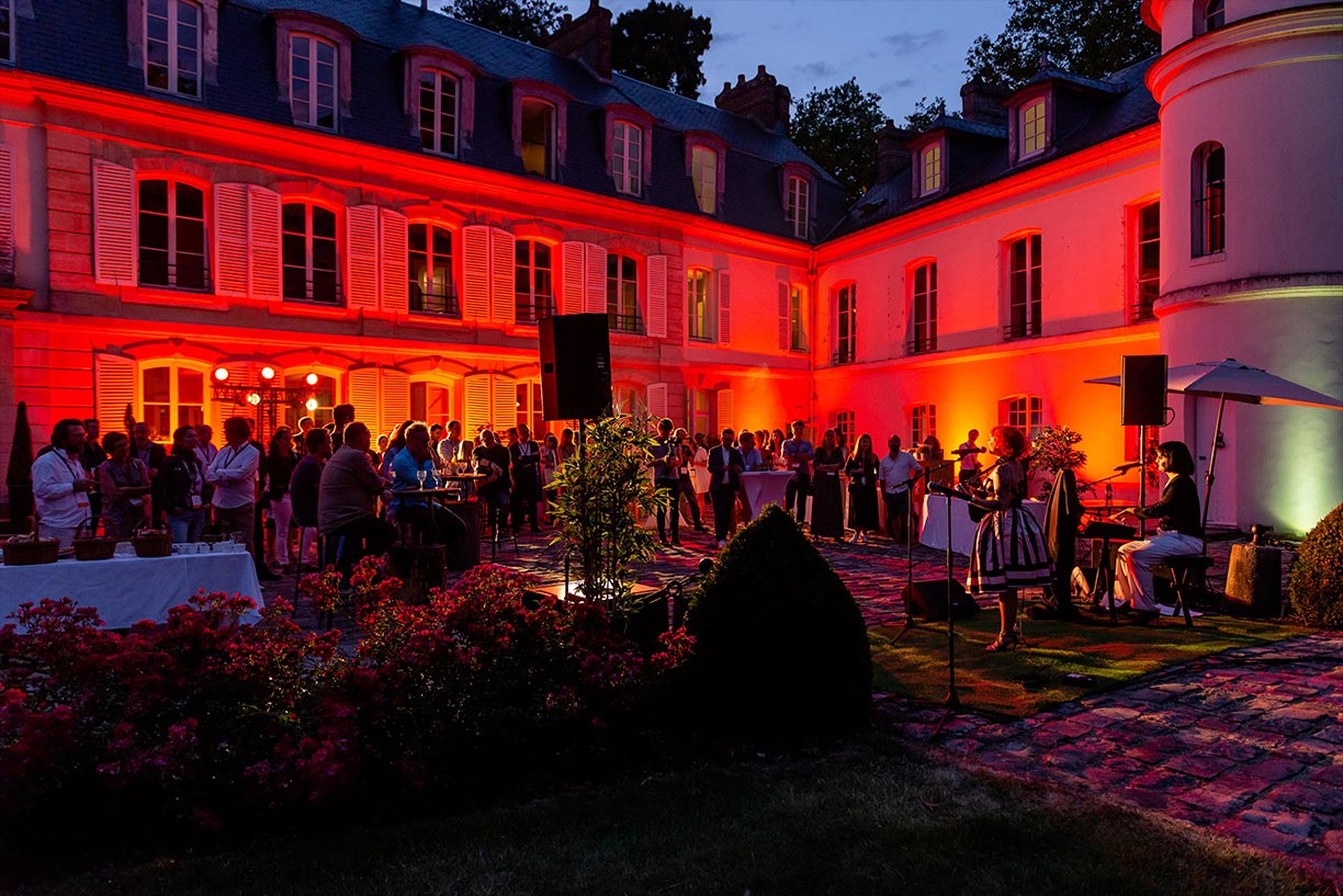 Attendees during the evening festivities at the Boma France Campfire. Credit: Boma France
