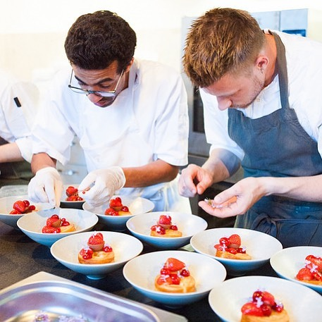 Our incredibly talented pastry chef @dessertkokken (left) assembling dessert: puff pastry, rhubarb jam, jeweled early summer fruits, strawberry pate de fruit, wild herbs, and fresh milk ice cream.  #immersive #foodporn #dessert