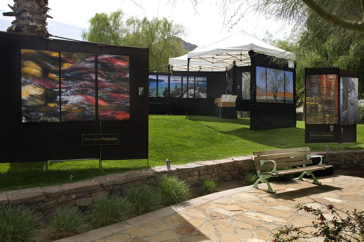 We set up at Art Festivals and Shows, usually outdoors. This is our booth at the La Quinta Arts Festival.
