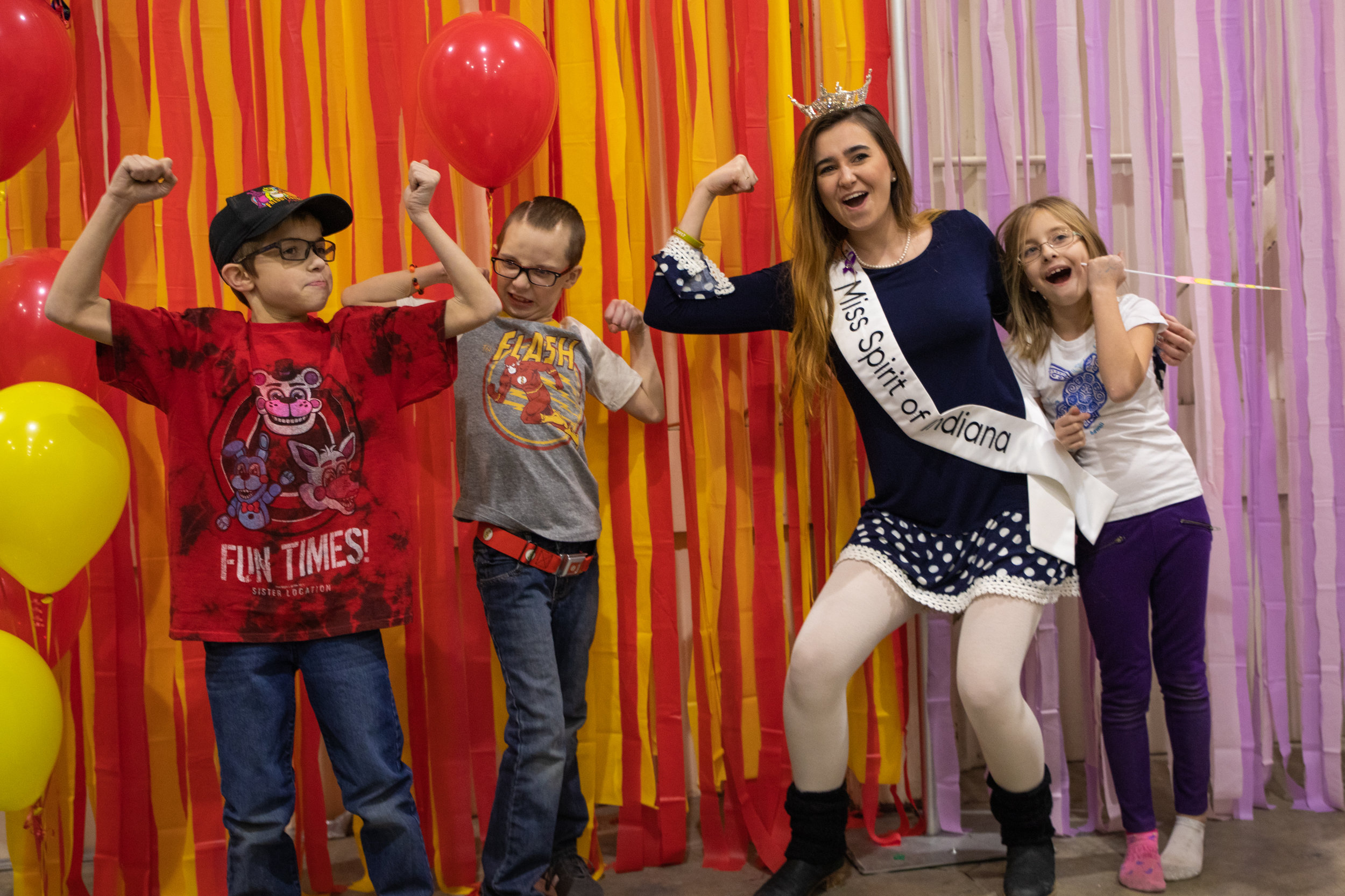 Elijah, Christian, Miss Spirit of Indiana and Grace all show their muscle guns for a photo at the 8th Birthday Bash. Flash and Unicorn decorations covered MadJax during the party Feb. 17, 2019.