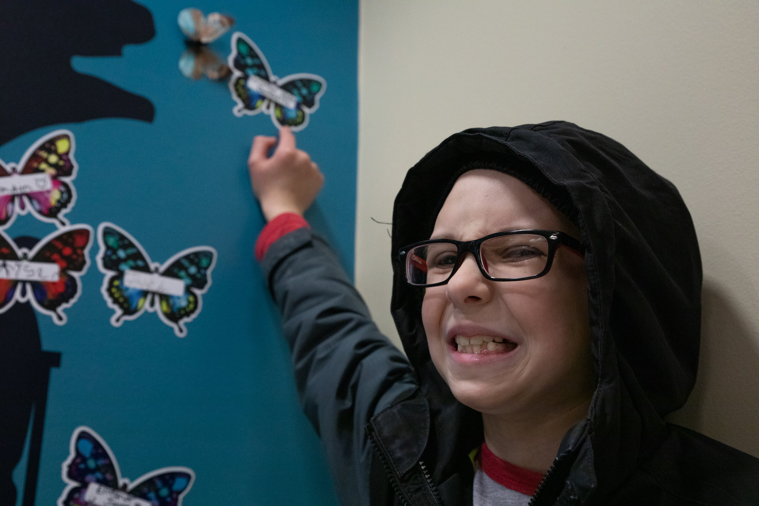 Christian points to his butterfly in Riley Hospital. The butterfly was signed by Christian on his last day of physical therapy during his original 66 day visit to Riley Hospital.  | PHOTO BY MADELINE GROSH
