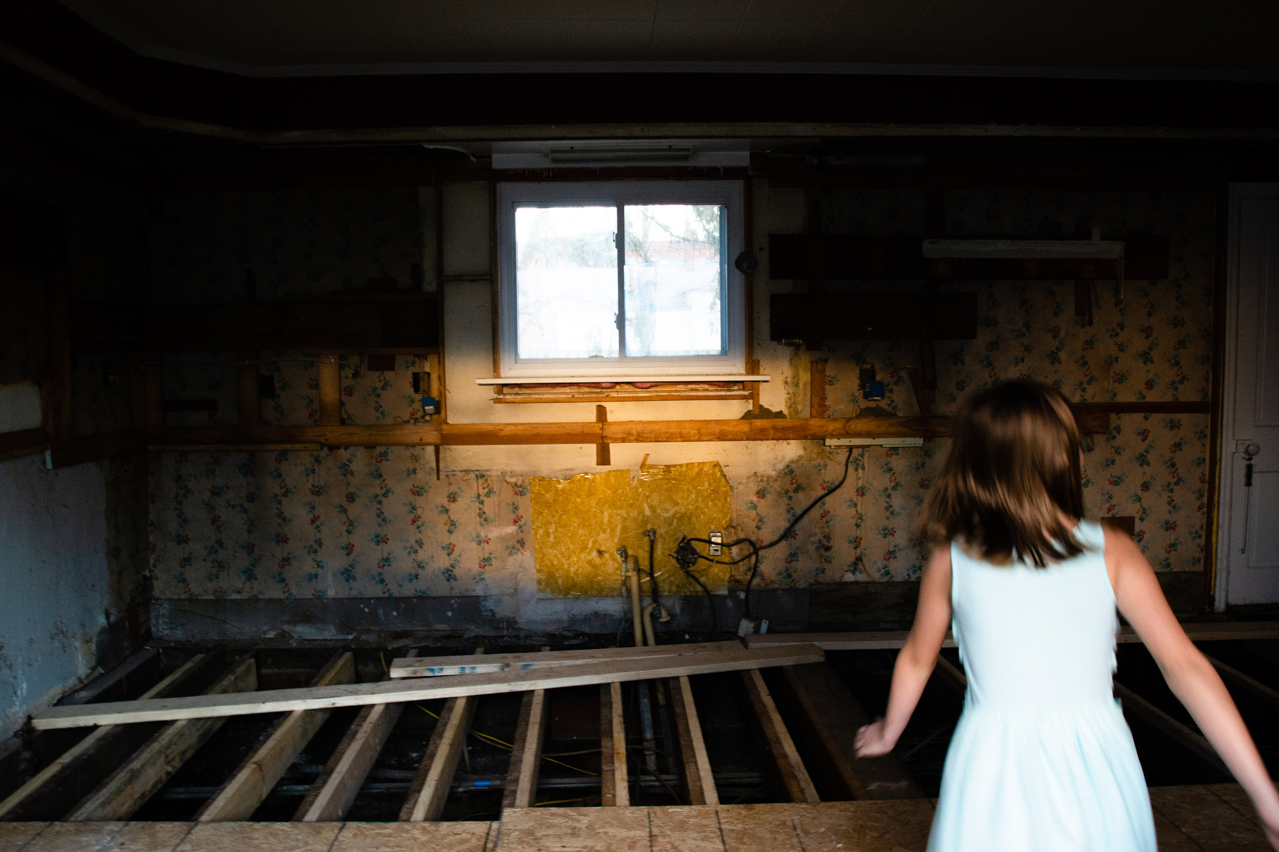 Grace, Christian's twin sister, runs though their house during renovations in the spring of 2019. While caring for their four kids, the family had loss touch with the state of their house and discovered electrical, plumbing and structural problems.  | PHOTO BY MADELINE GROSH