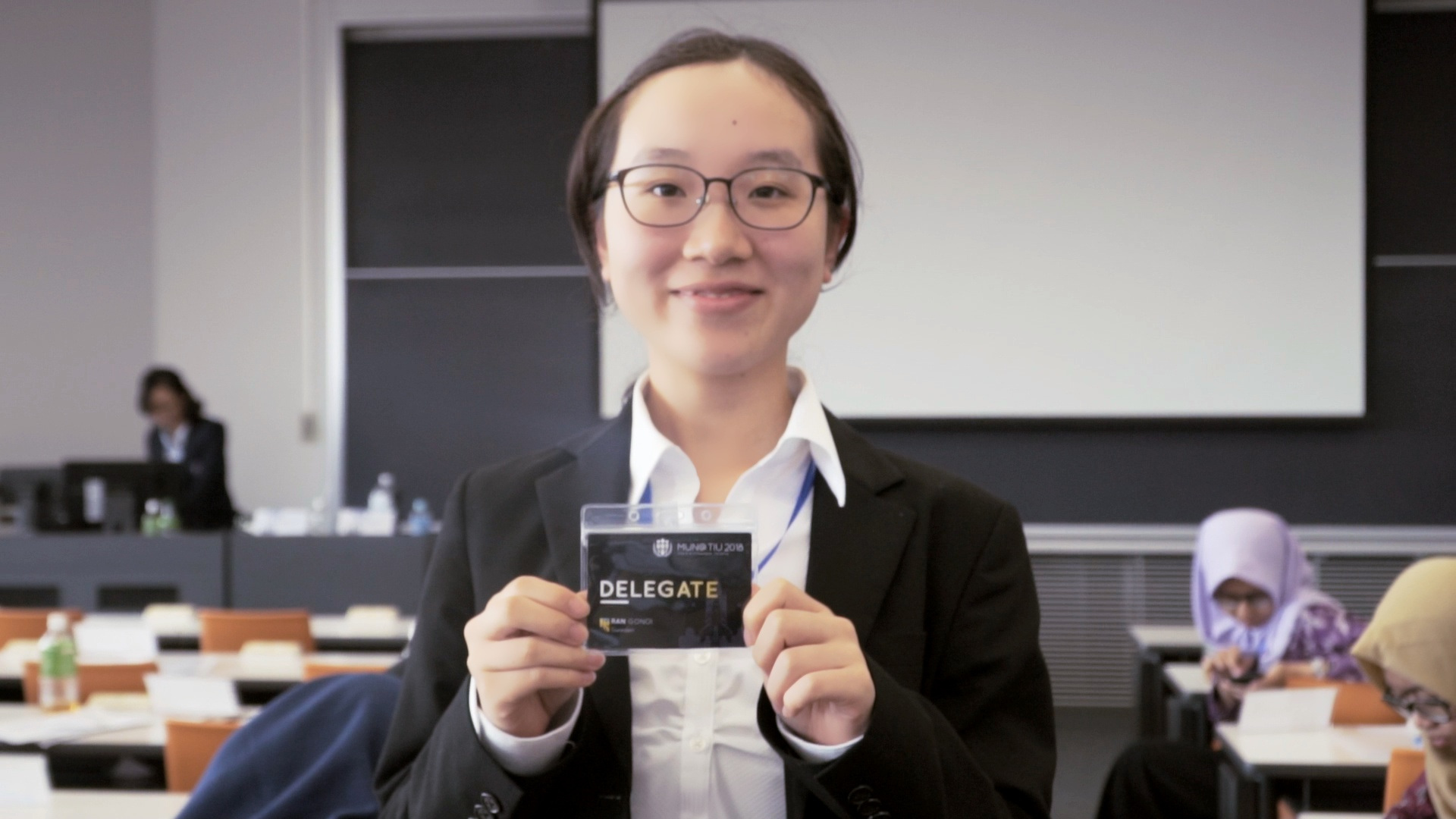 The Delegate of Sweden showed off her fancy early-bird exclusive name badge.