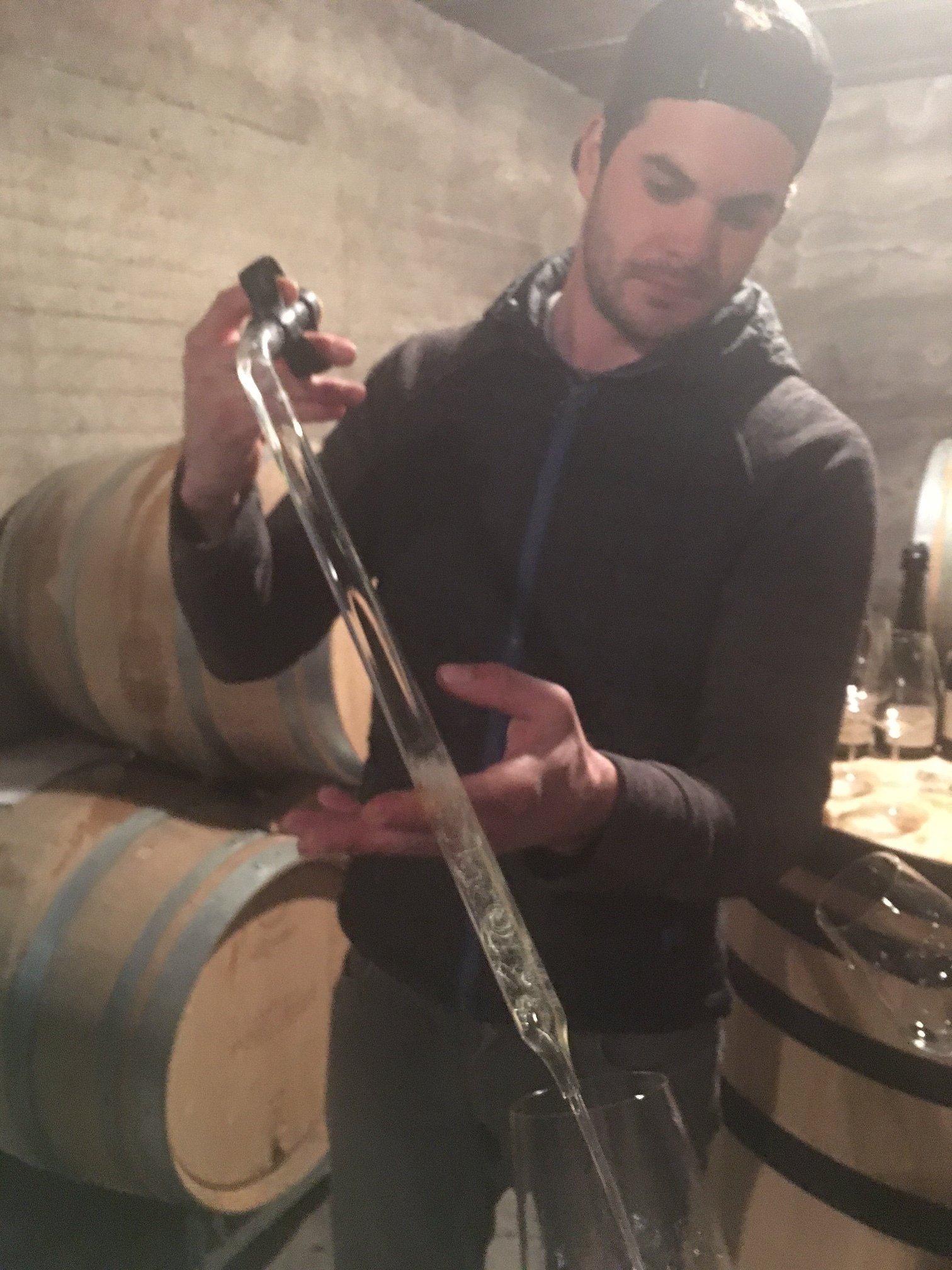 Adrien Dhondt pours us a sample from barrel