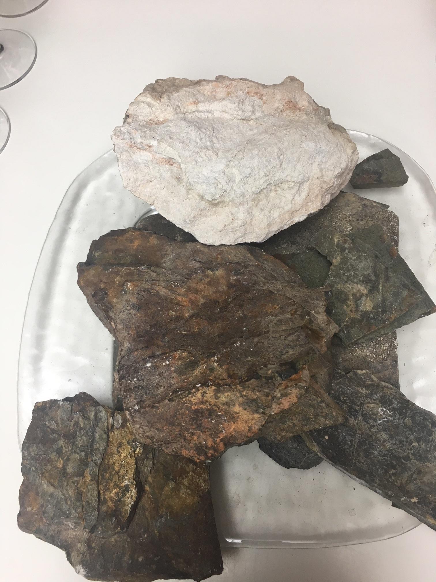 Limestone (white), Llicorella (dark slate), clay (brown)