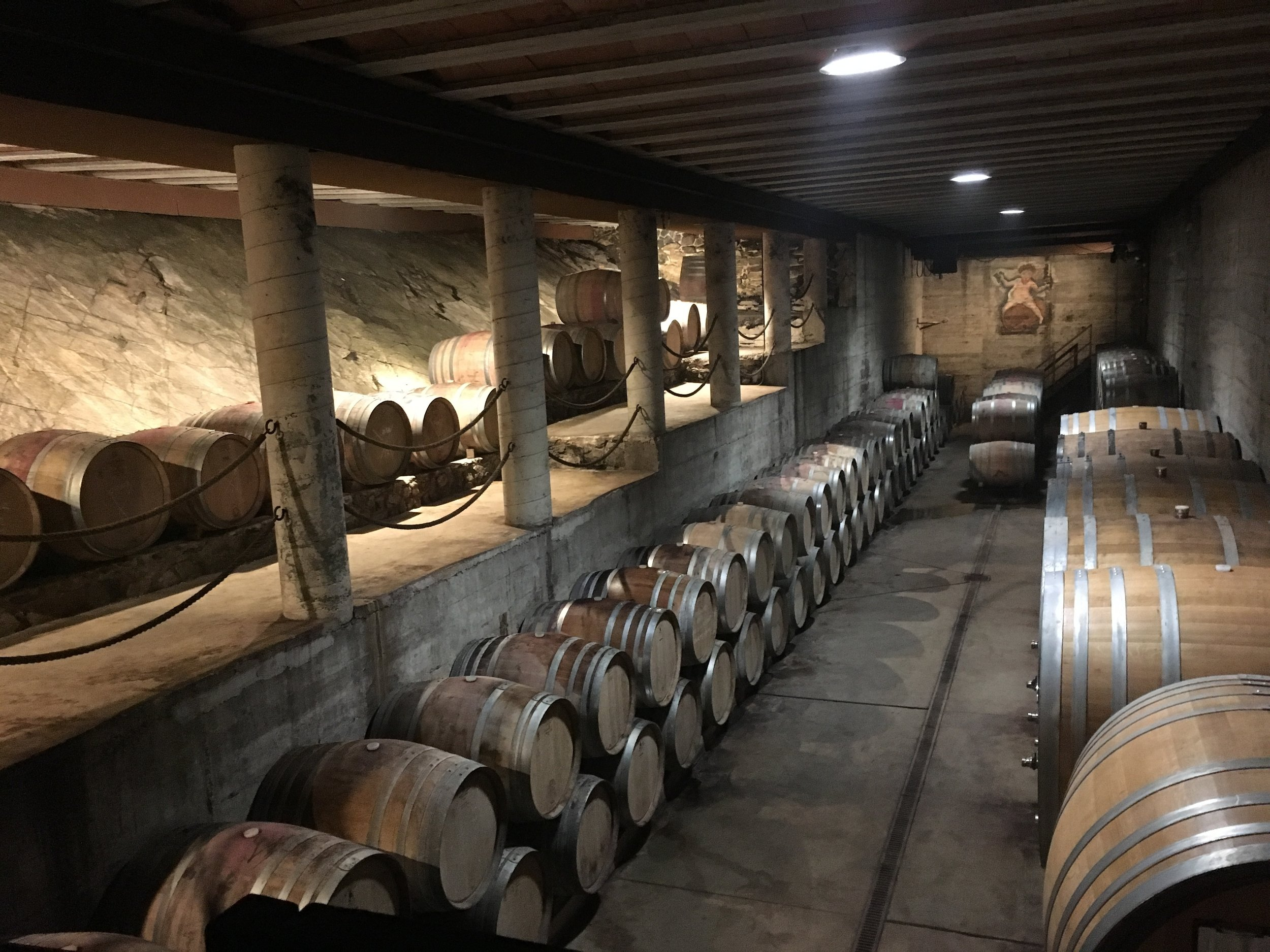 The Clos Mogador cellar is carved into the rock on the top of a mountain