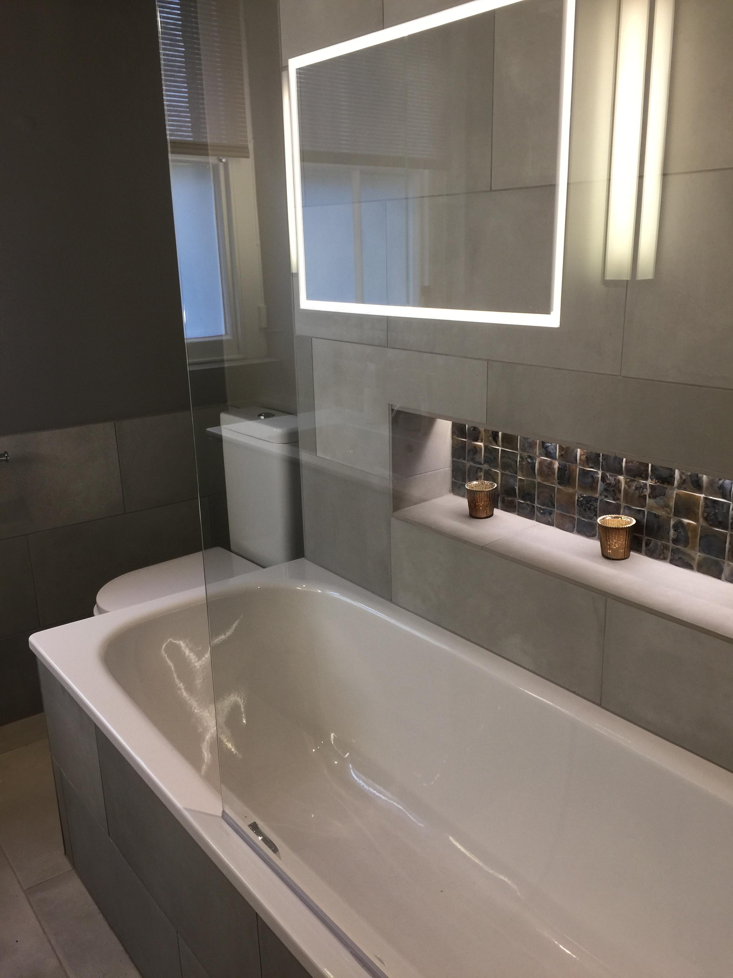 Bathroom  lighting design  Back lit shelves creating a glamorous feel.
