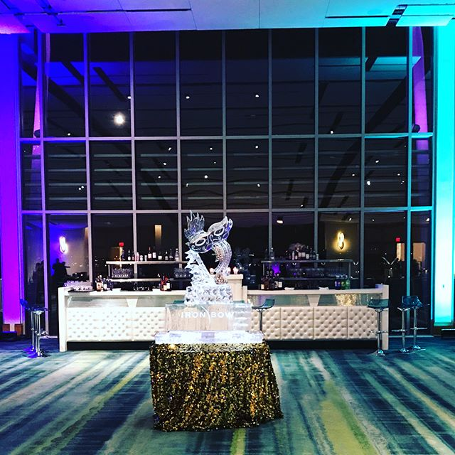 Masquerade ball for Corporate Party @gaylordnational with dazzling linens, fun mask center pieces, branded ice carving, casino & cool cosmo bar! #corporateparties #masqueradeball #nationalharbor #corporateevents #masqueradetheme #osborneevents