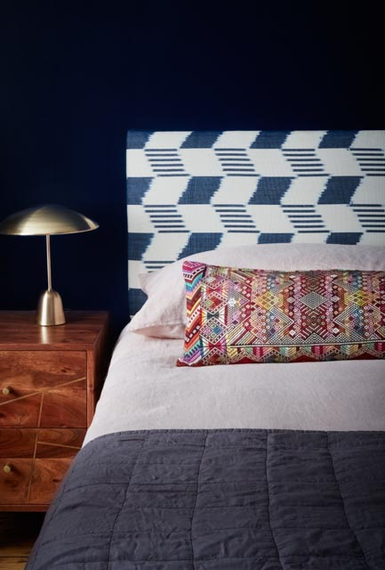 Tanchi Ikat Indigo Ikat Headboard with Tahul Brocade Oversize Bolster Cushion - A Rum Fellow.jpg