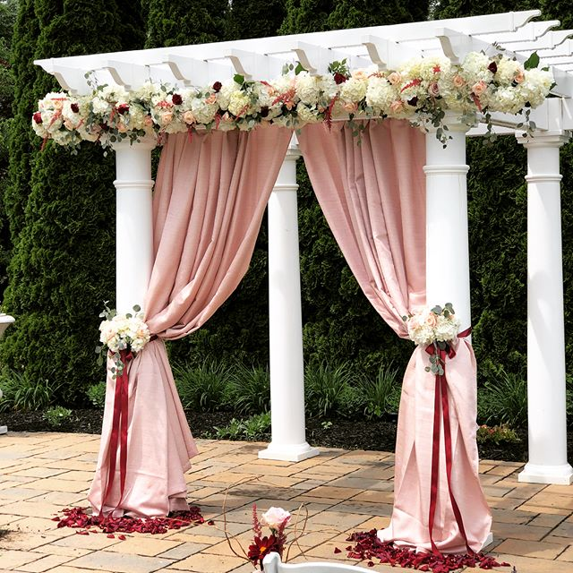#destinationwedding #archdecor #drapery #orlandoflorist