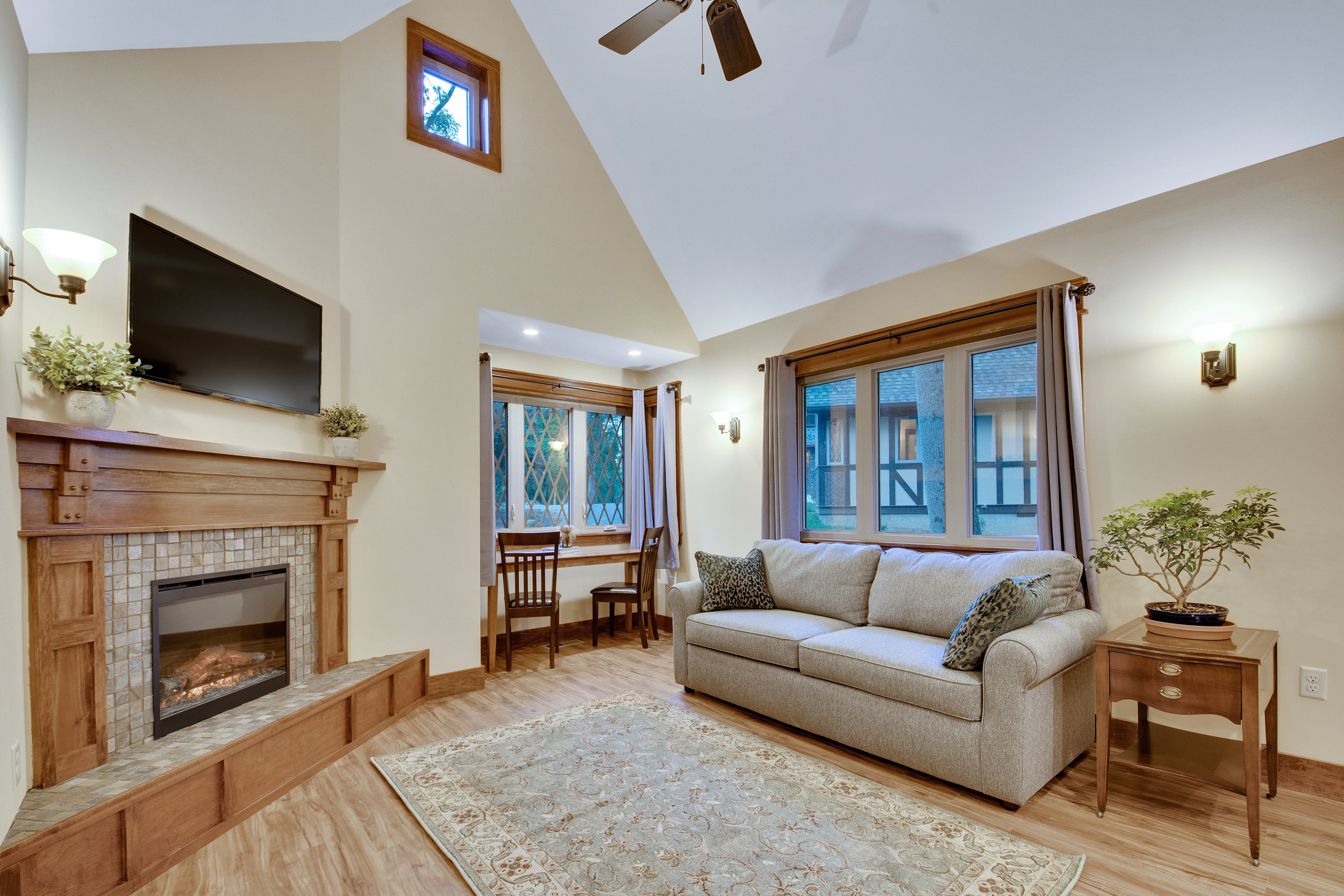 Cozy living room with dining nook and fireplace
