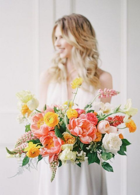 Making Your Florals POP - Add shades of citrus toned blooms to your flower choices, they are sure to stand out against your beautiful white dress.