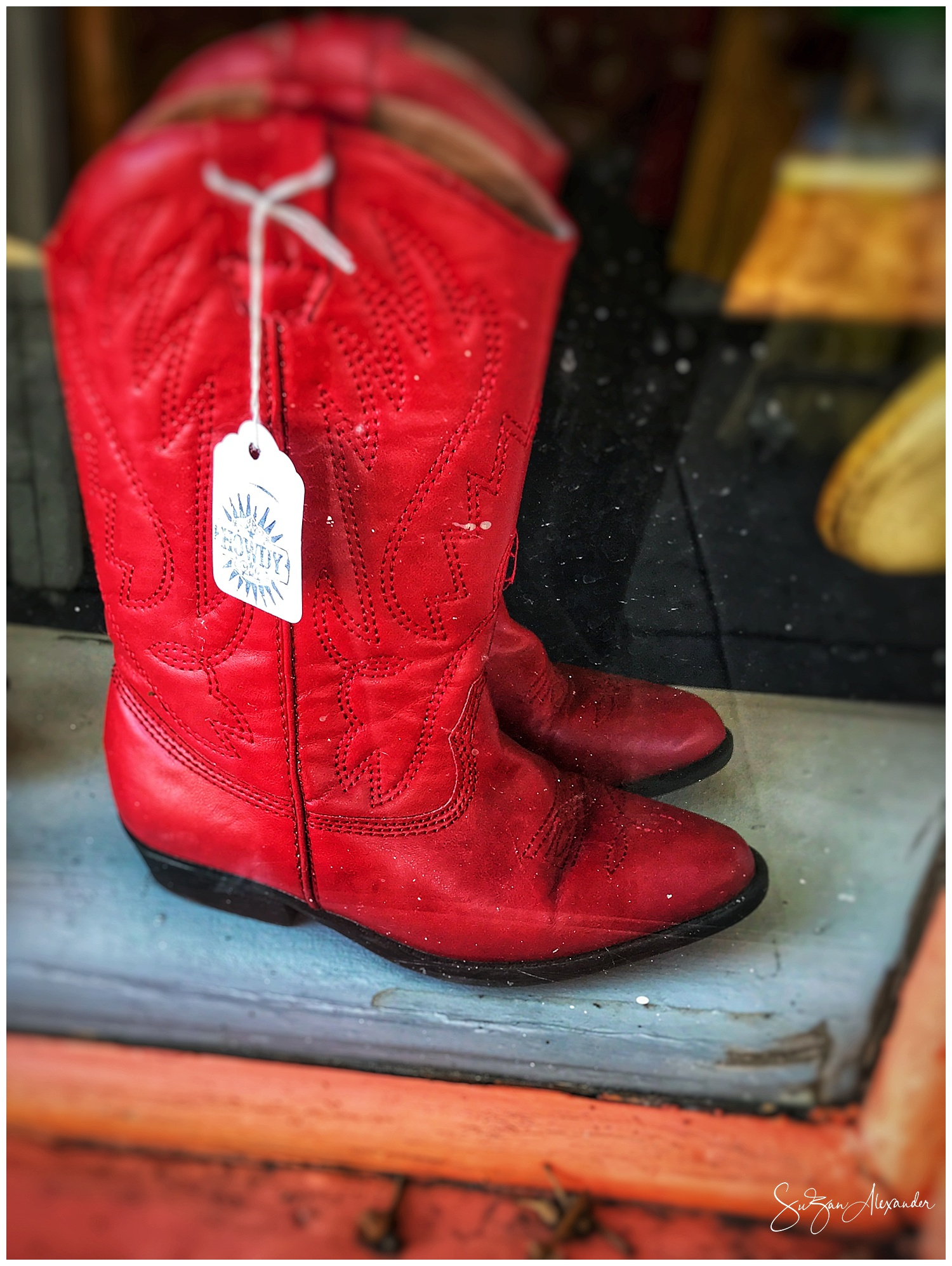 © 2018 SuZan Alexander. Little Red Boot in the Store Window. iPhone 7 Plus