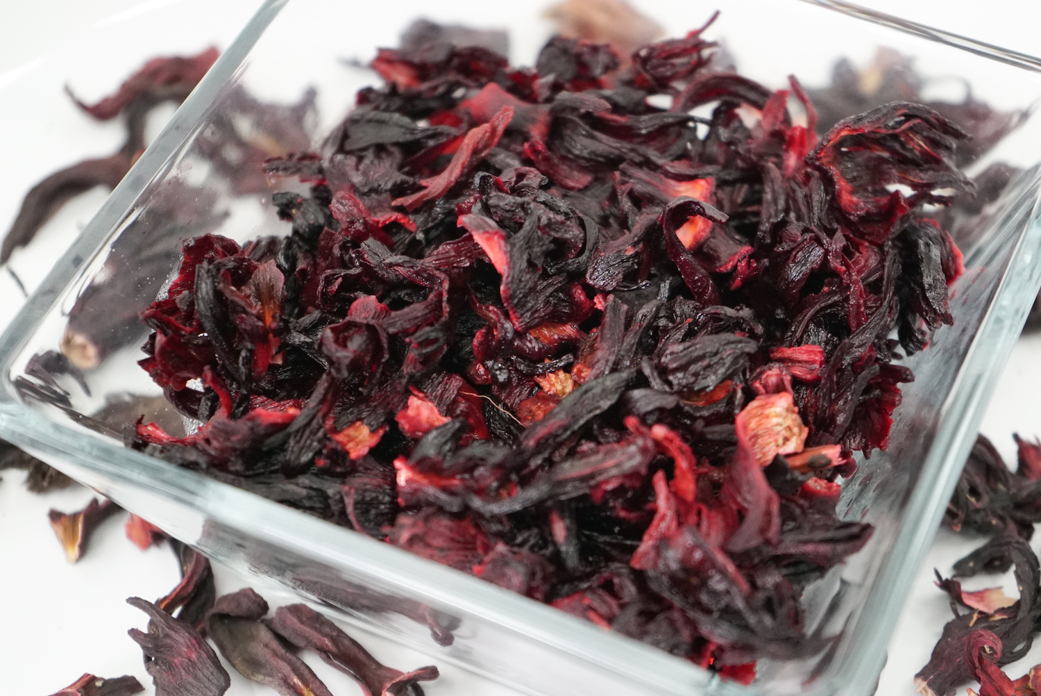 Sorrel is made from brewing the flower petals of the roselle plant, a type of hibiscus that is native to India. The plant way brought to Africa and then to the New World. The drink is made by boiling the dried petals, above.