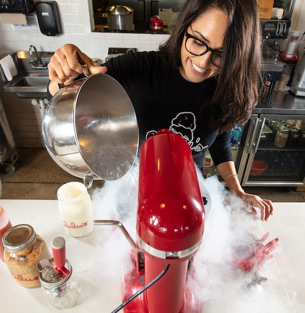 Luisa Santos pours liquid nitrogen over a vanilla cream base at Lulu's Nitrogen Ice Cream in Miami. Photography by Libby Volgyes