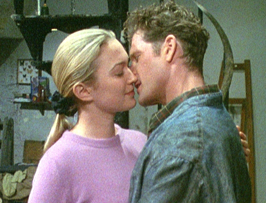 Louise (Sophia Myles) & Matt (George Asprey) kissing.jpg