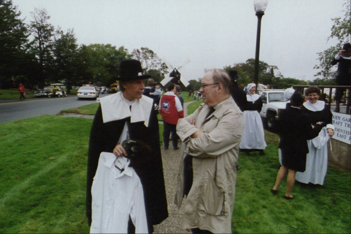 John Ames (right) of the First Presbyterian Church talking to a parade participant